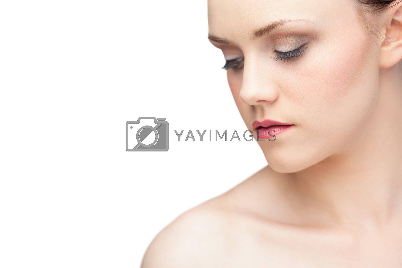 Pensive gorgeous brunette posing by Wavebreakmedia