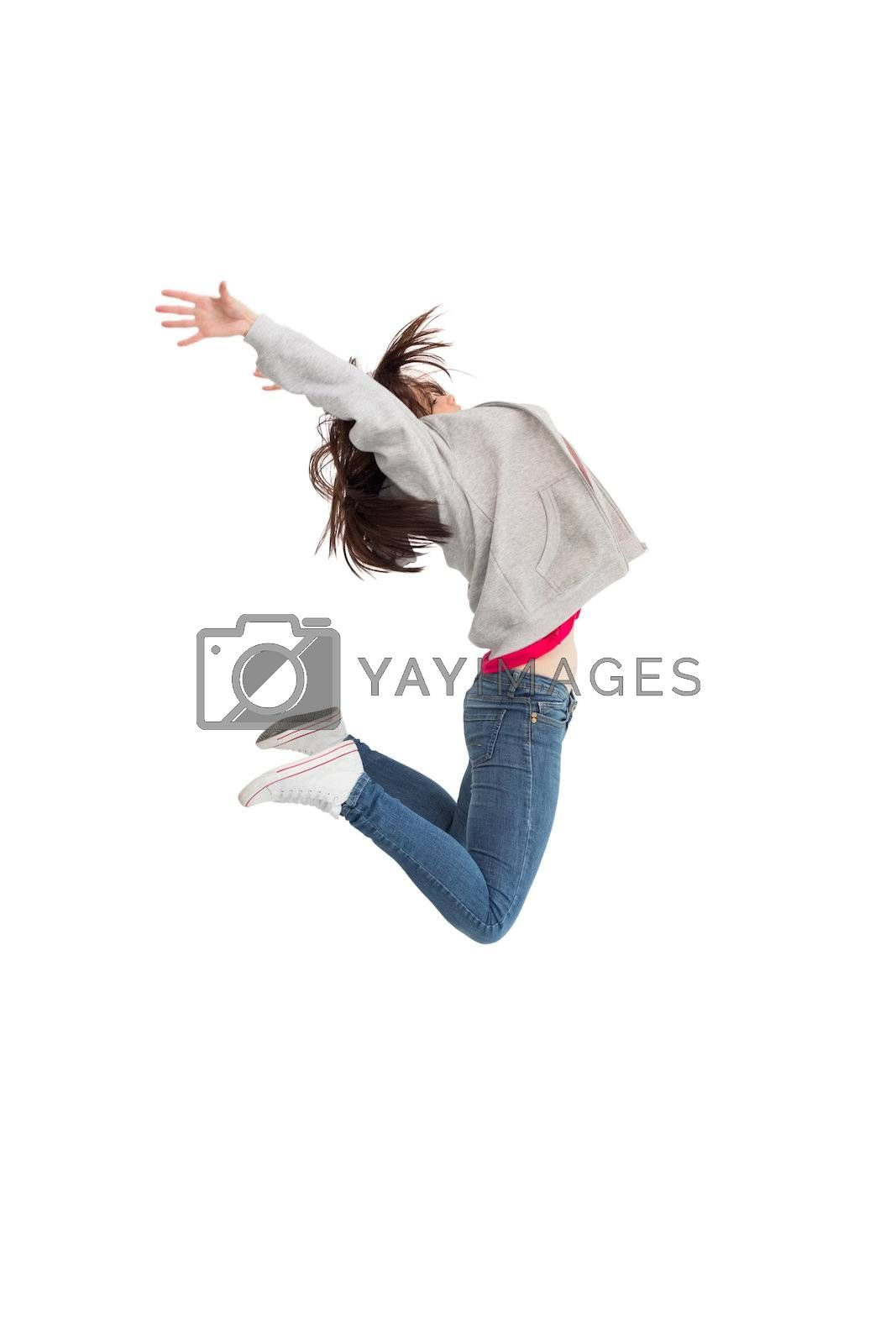 Cheerful young woman jumping by Wavebreakmedia