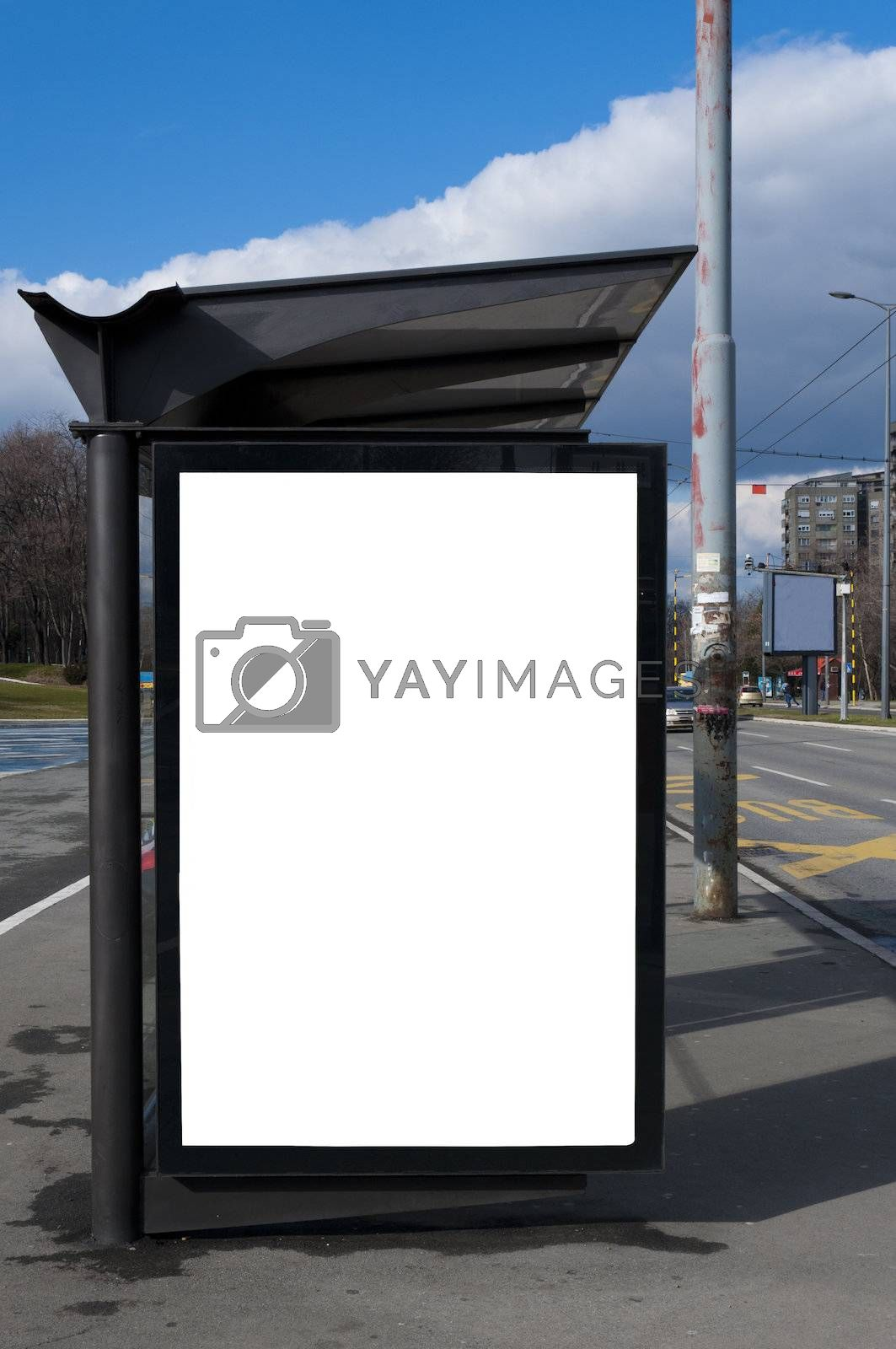 Bus stop with the blank bilboard