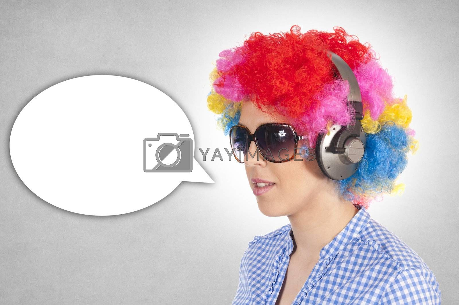 Female with clown wig and headphones on gray background