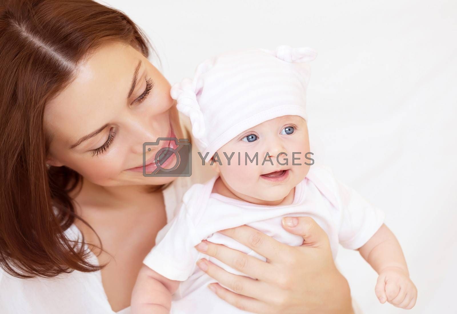 Closeup portrait of mother looking on her cute toddler, happy baby girl with mom at home, happy togetherness concept