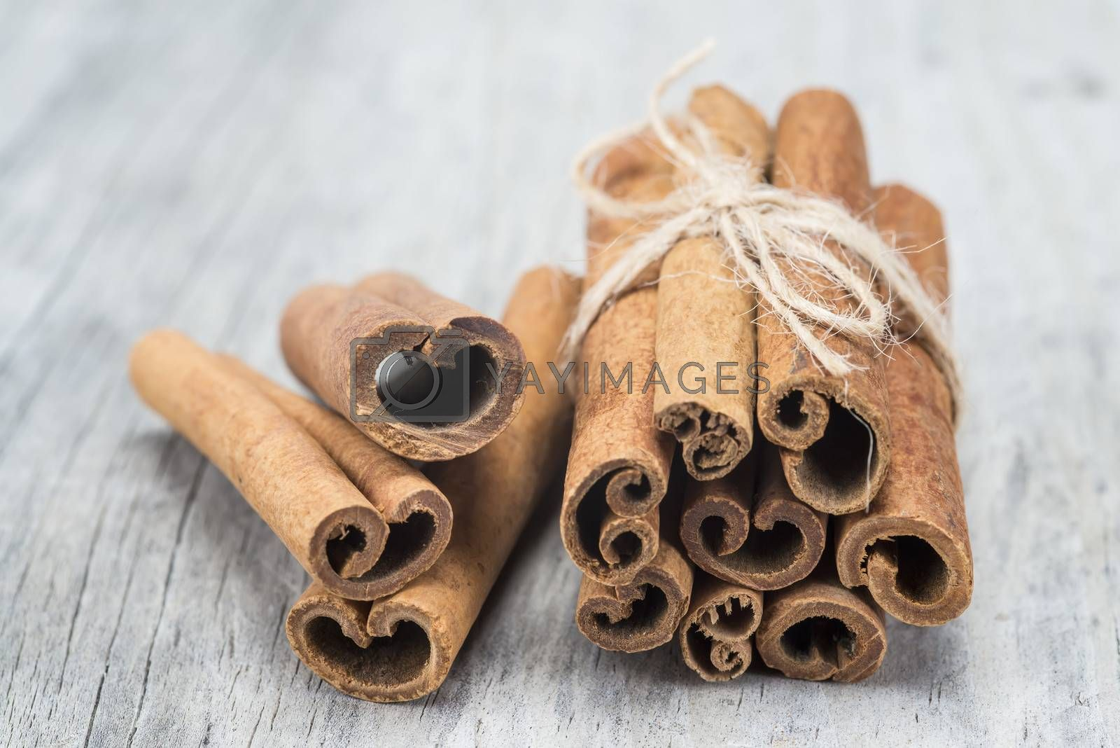 Cinnamon sticks on an old wooden table background
