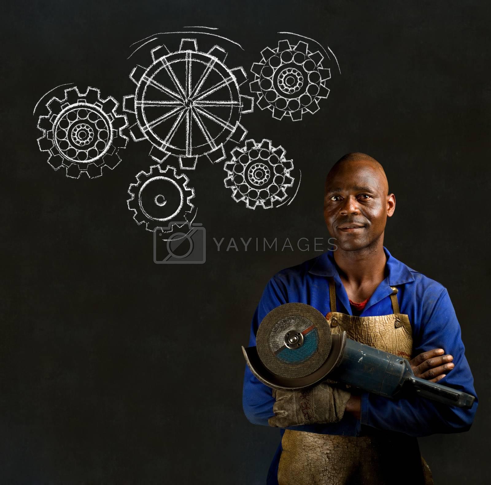 African American black man industrial worker with chalk gears on a blackboard background