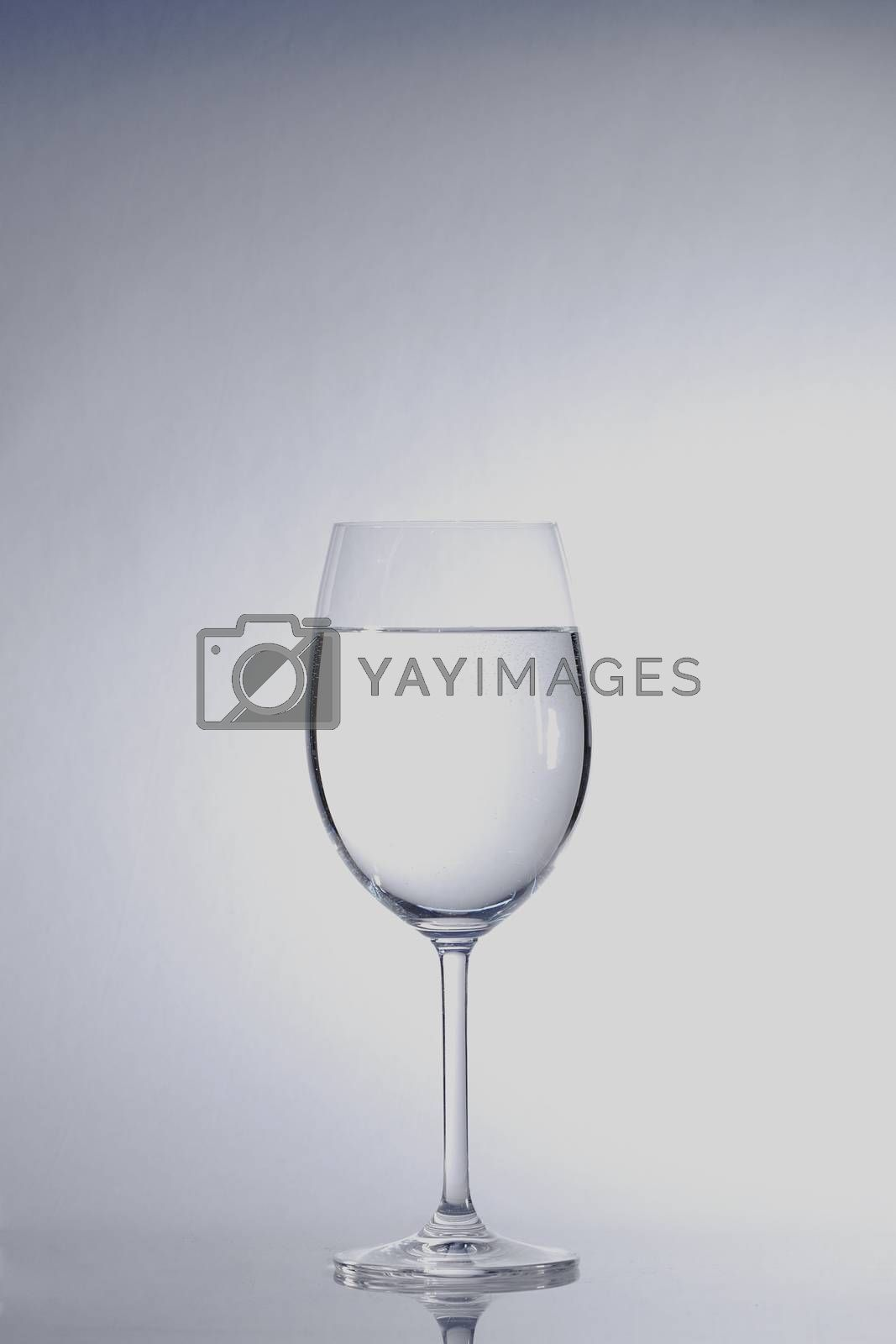 clear transparent water in the wine glass center
