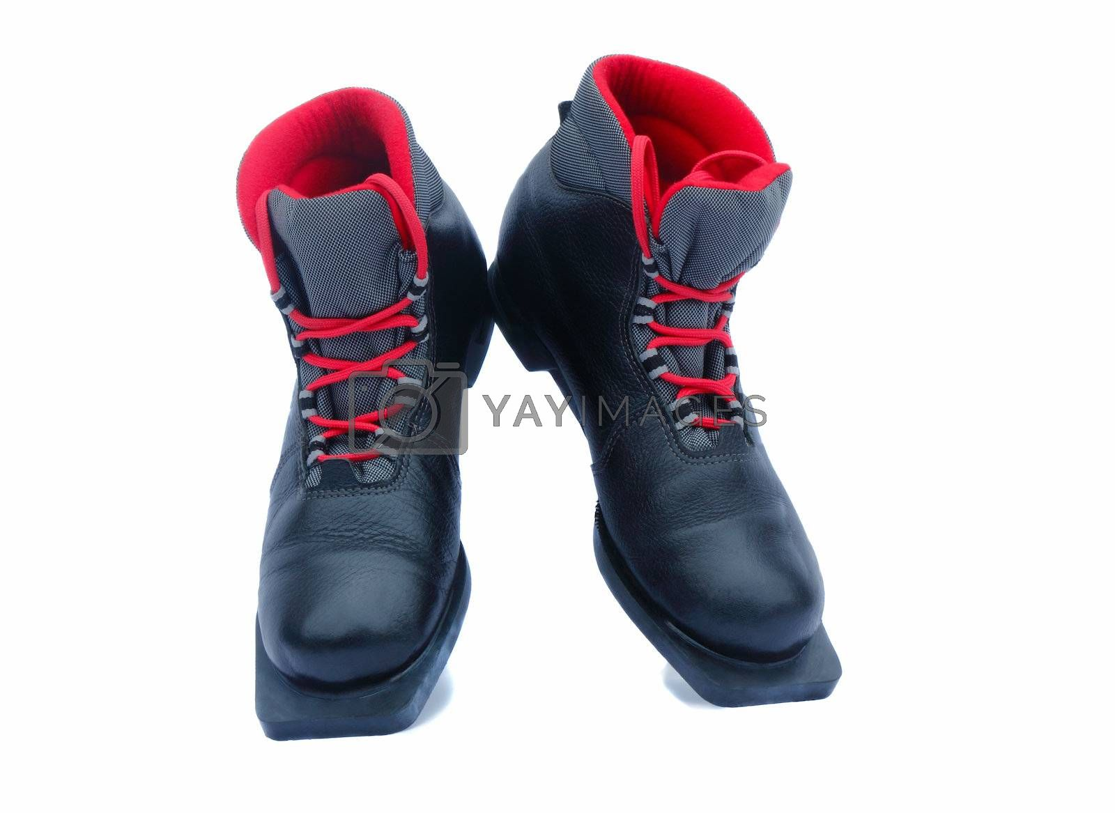 Leather black ski boots with a red lining. Are presented on a white background.