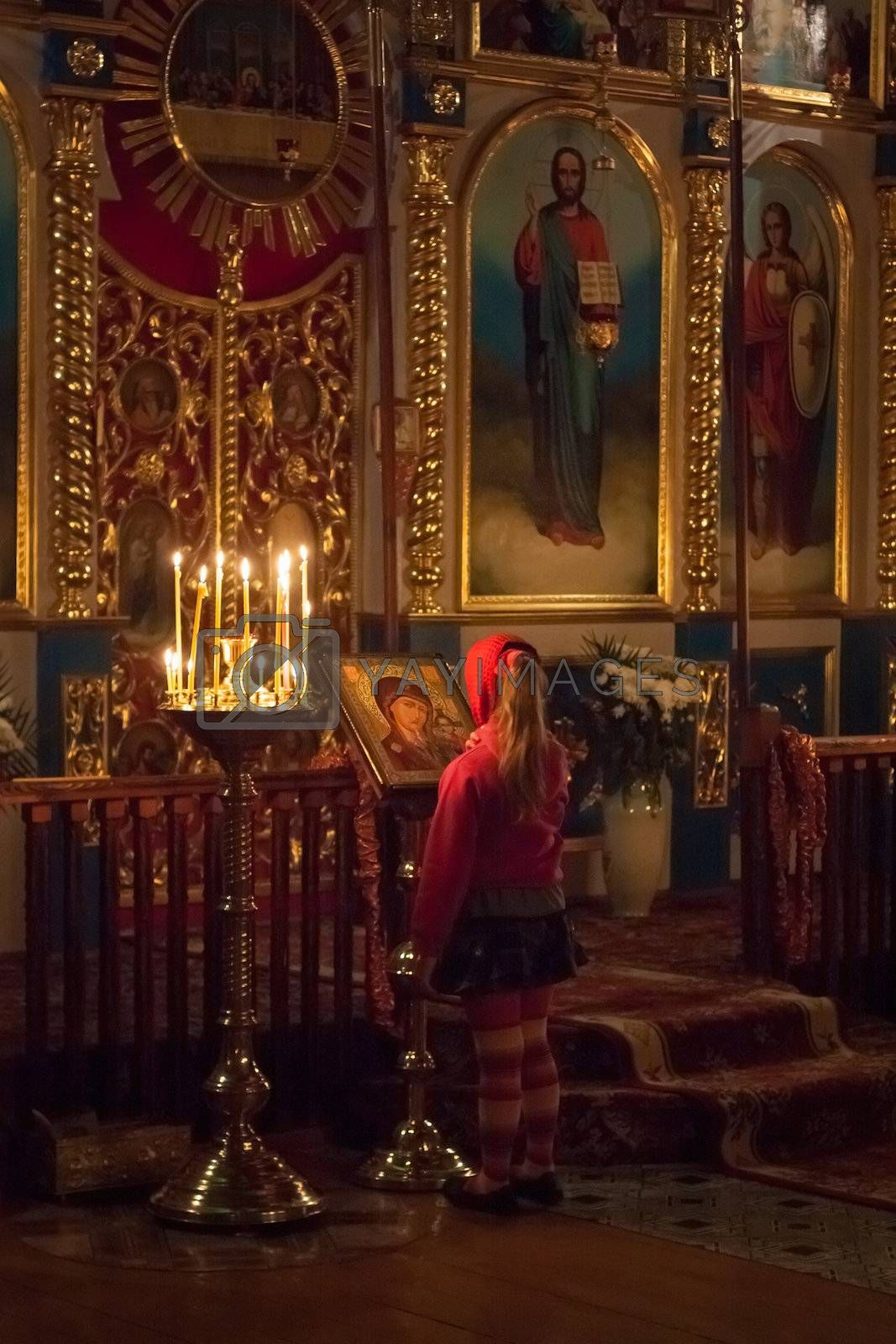 GOMEL - MAY 4: Little Girl Pray At Easter In Front Of The Icon In Belarusian Orthodox Church On May 4, 2013 In Gomel, Belarus