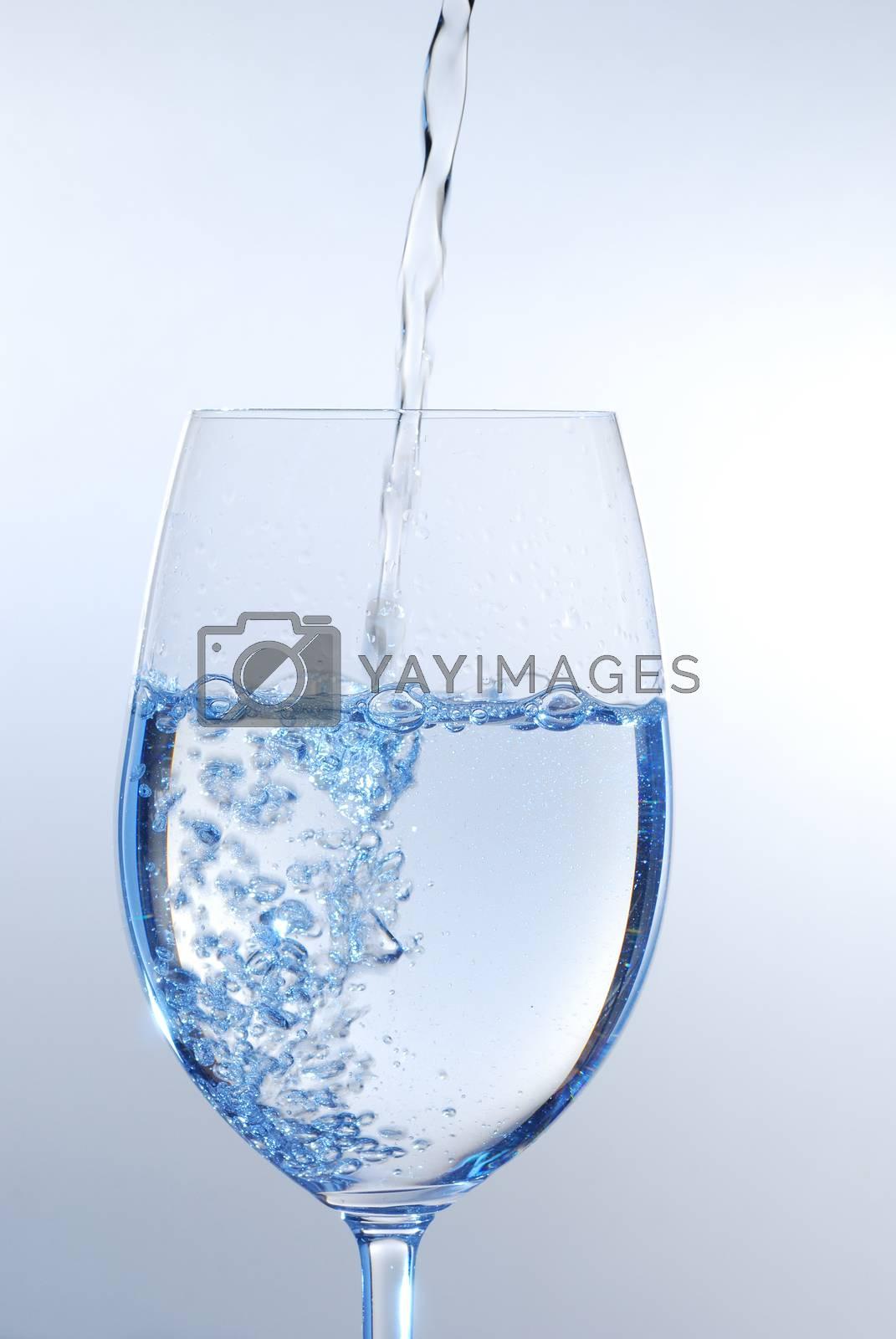 bubbling water in wine glass