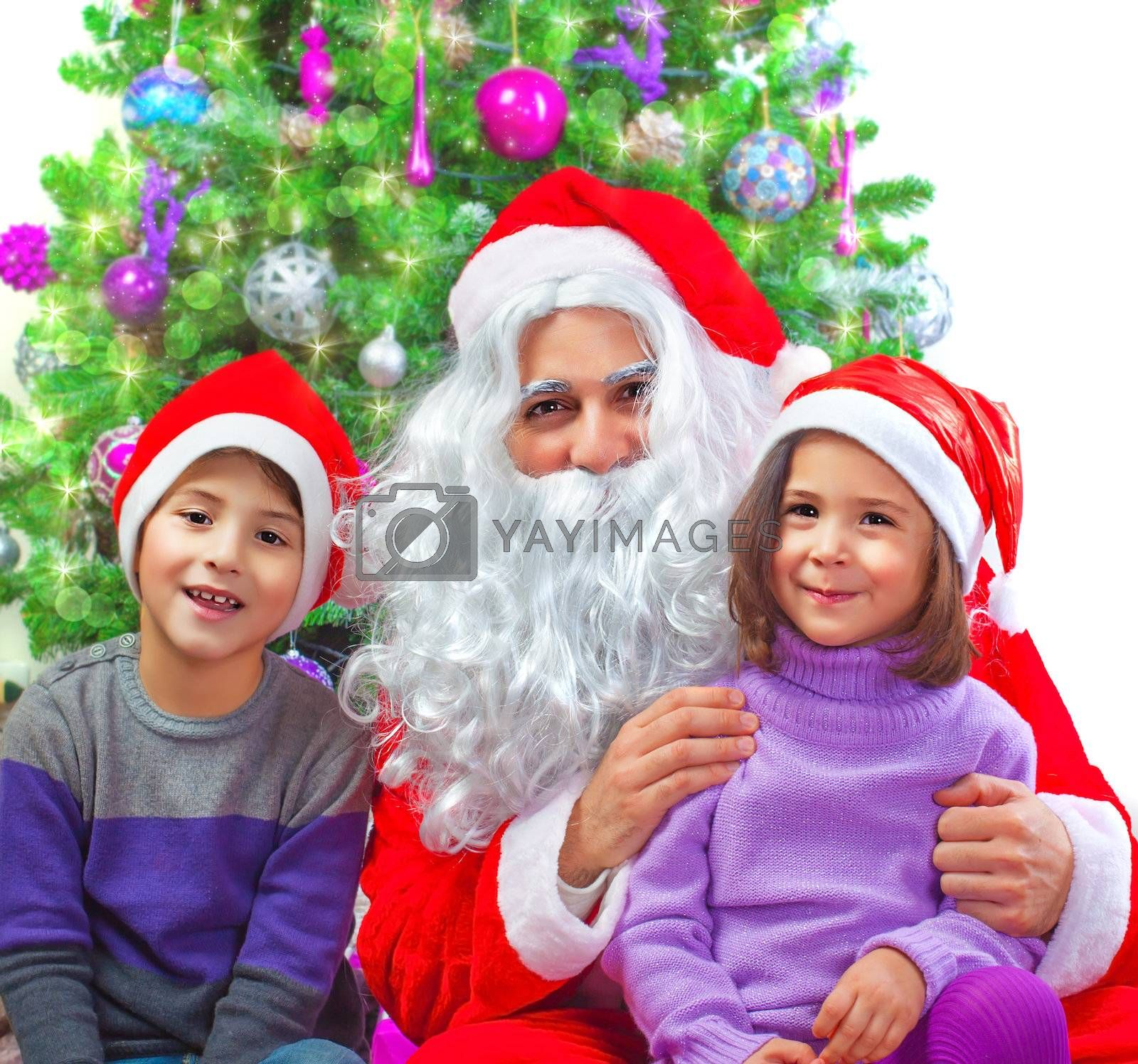 Portrait of two adorable kids sitting with Santa Claus at home near Christmas tree, winter holidays, New Year party, festive decorations, fun concept