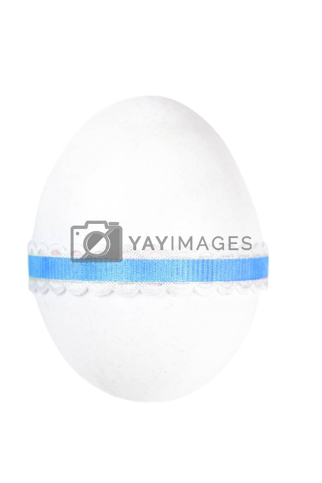 Single decorated egg isolated over white background