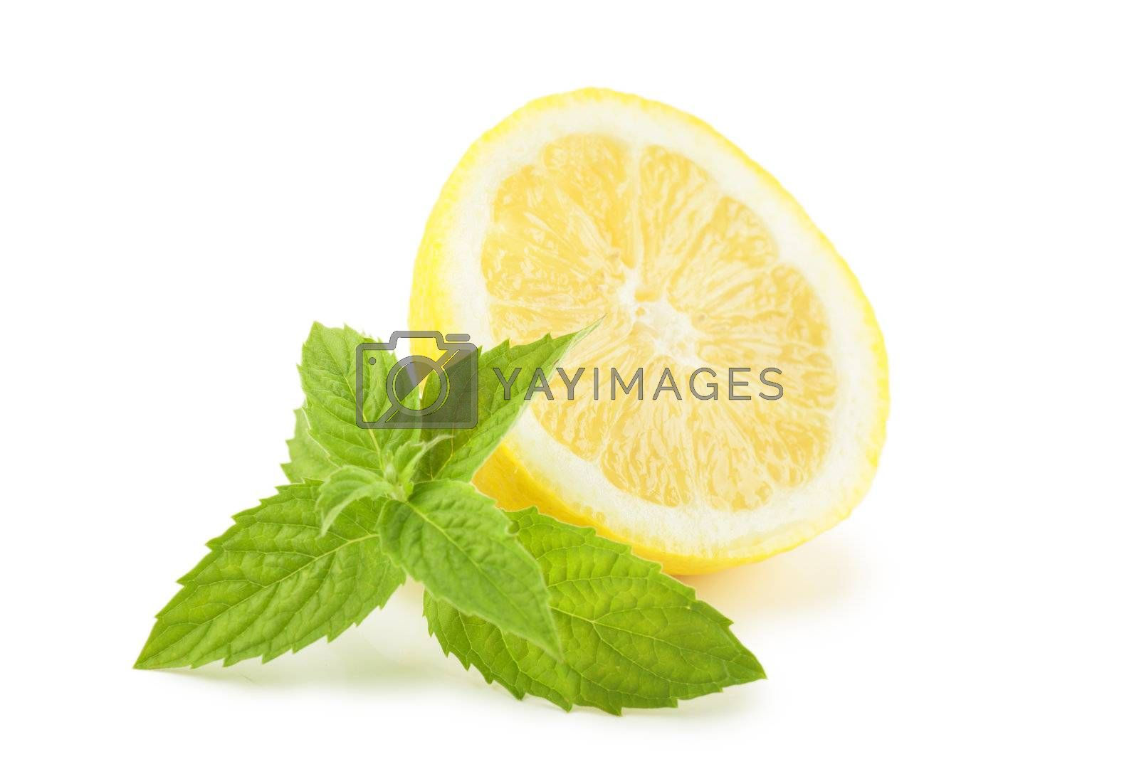 Lemon with mint leaves over white background