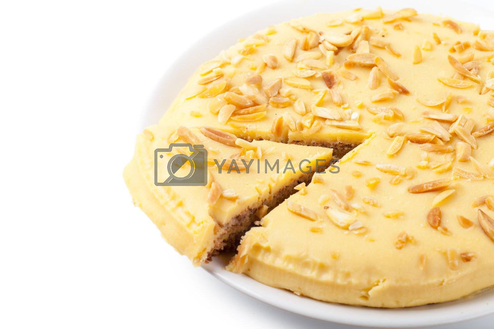 Closeup view of sweet pie with separated piece on a white plate