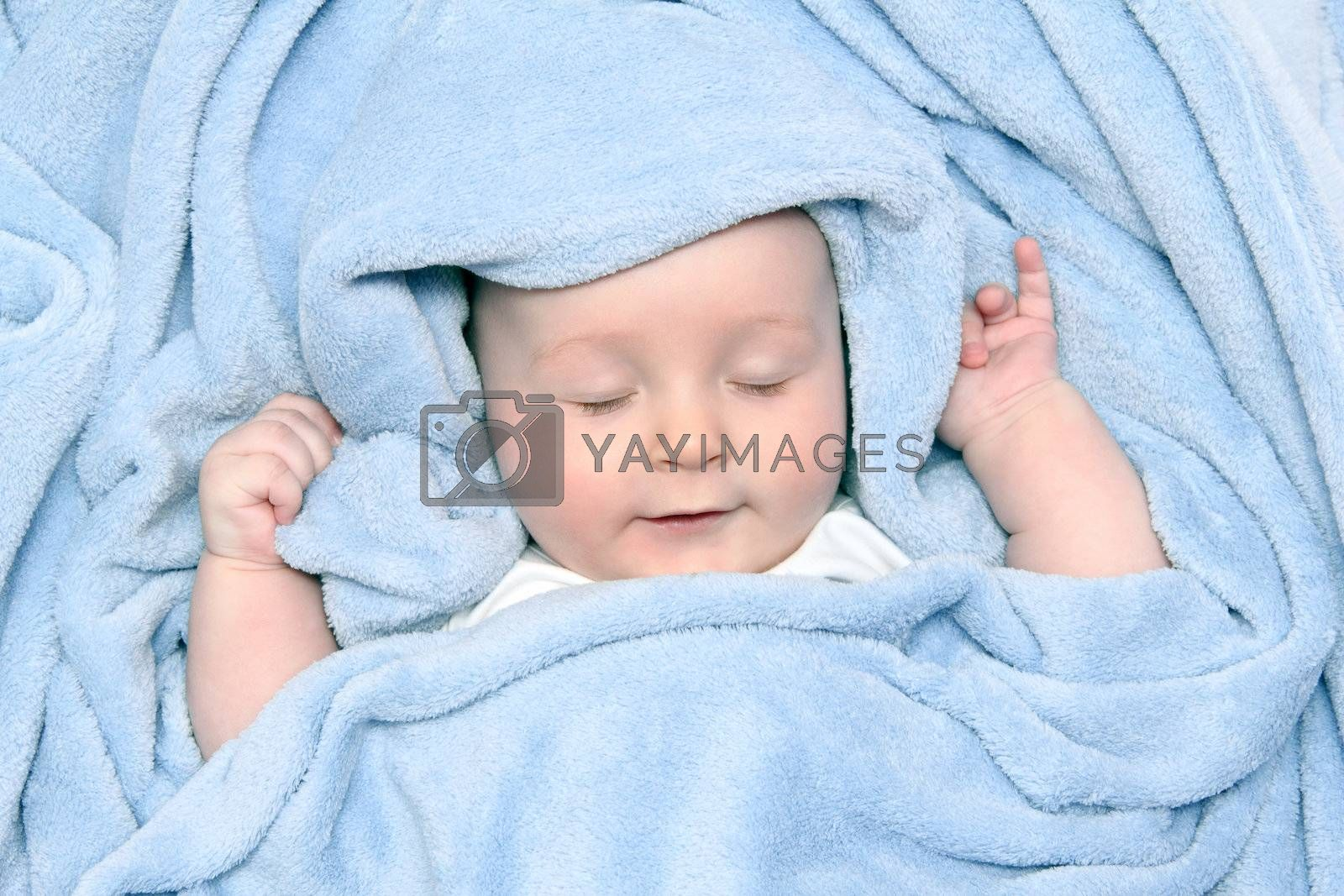 beautiful baby after bath under a blanket