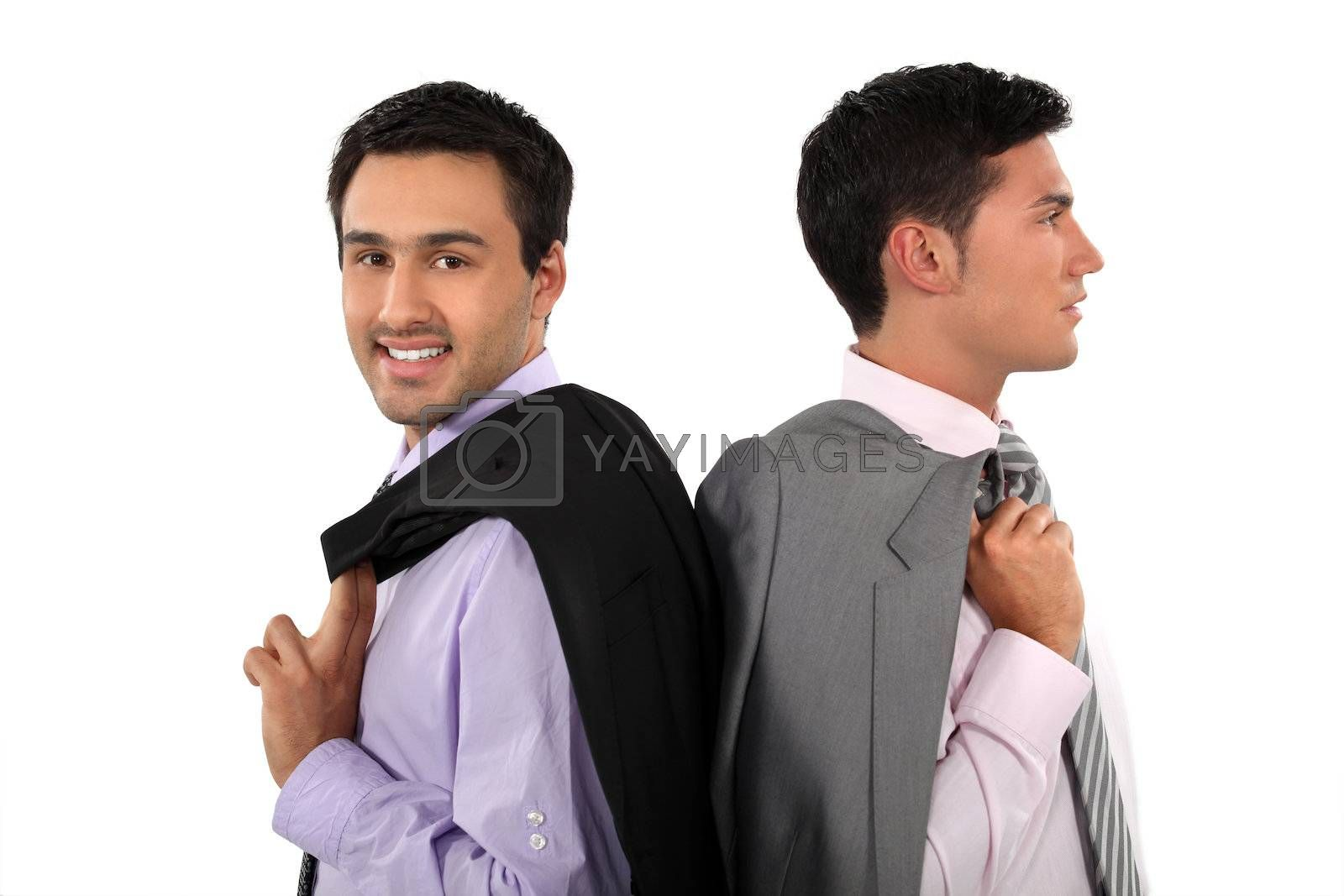 Two businessmen with jackets over shoulders