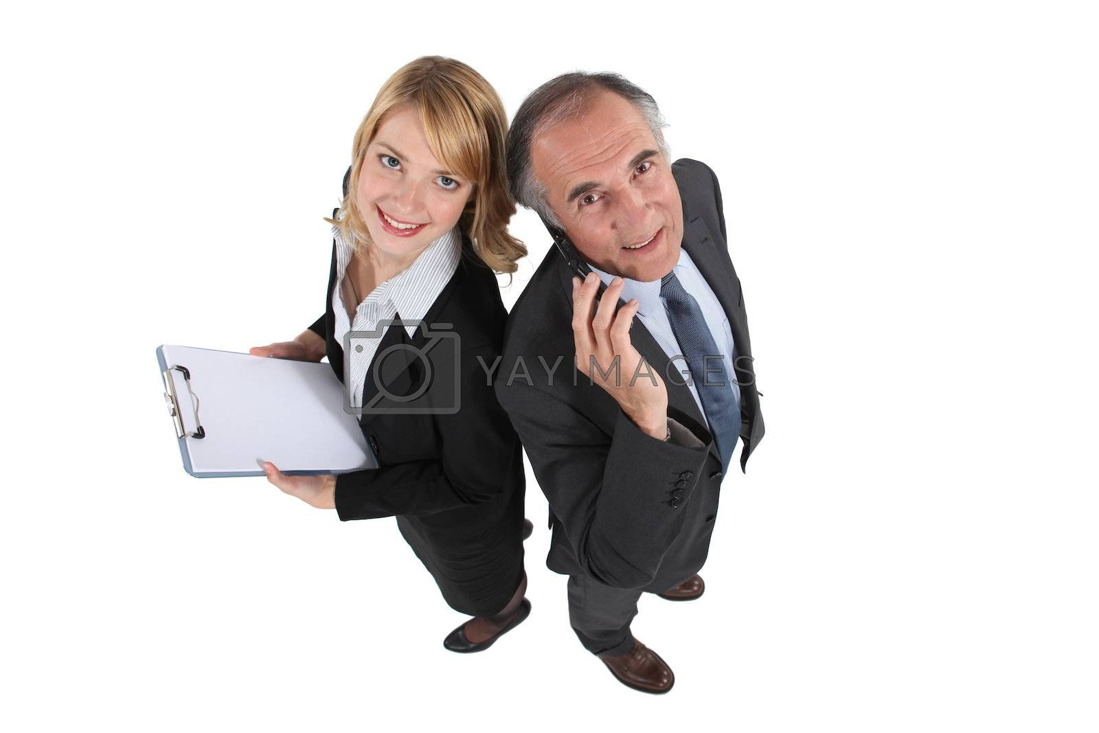mature businessman on the phone with female assistant