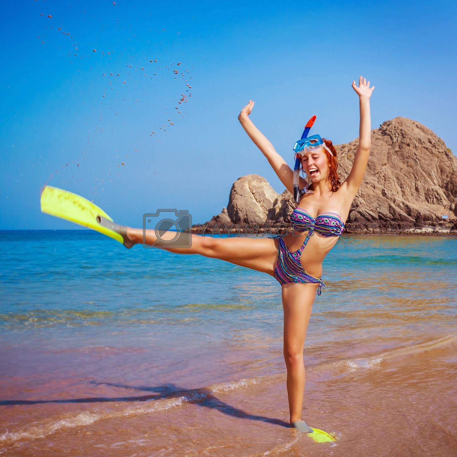 Happy funny girl wearing diving equipment, raised up hands, tropical resort, active lifestyle, summertime hobby, vacation and tourism concept