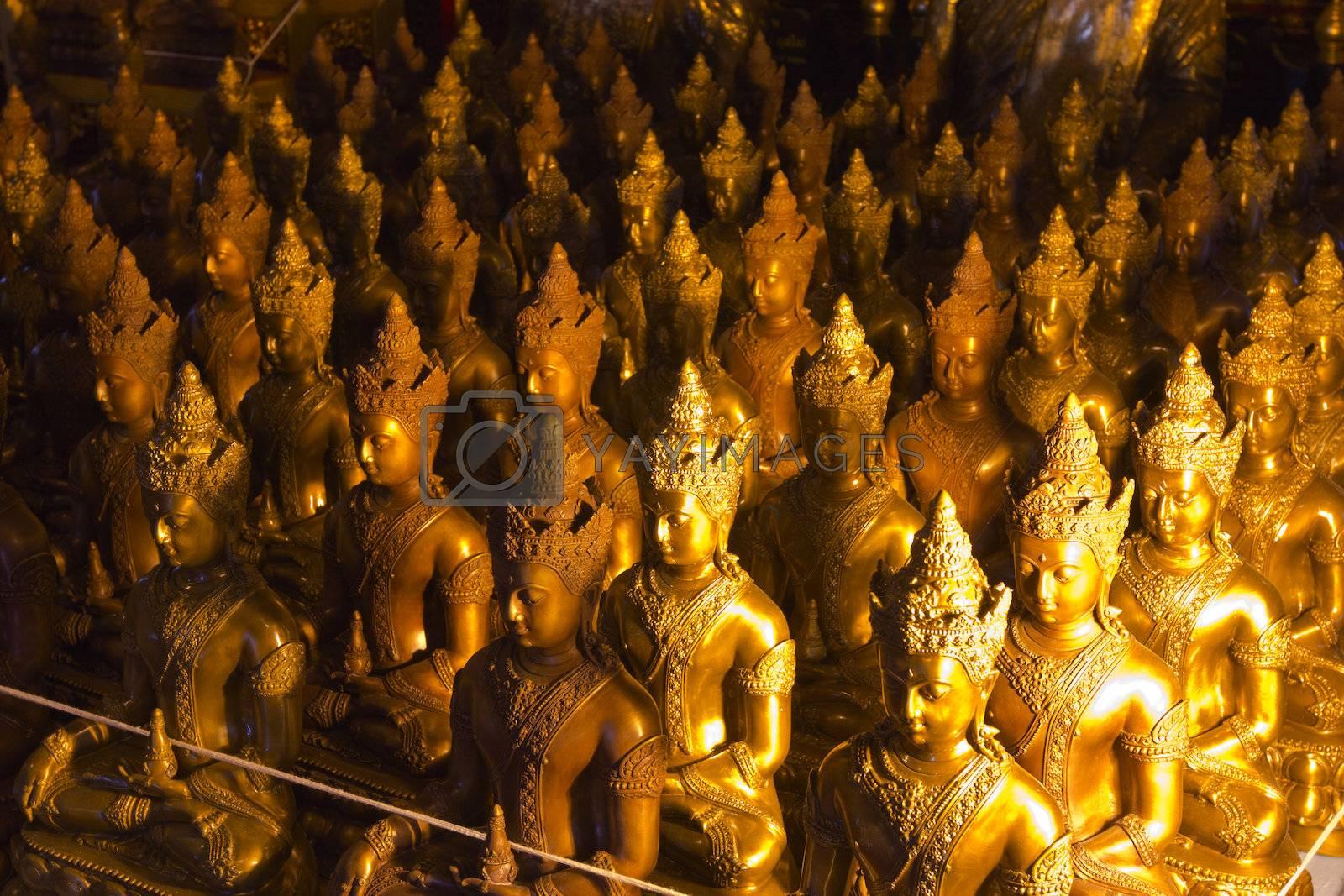 Seated buddha image in the attitude of subduing Mara with full regalia