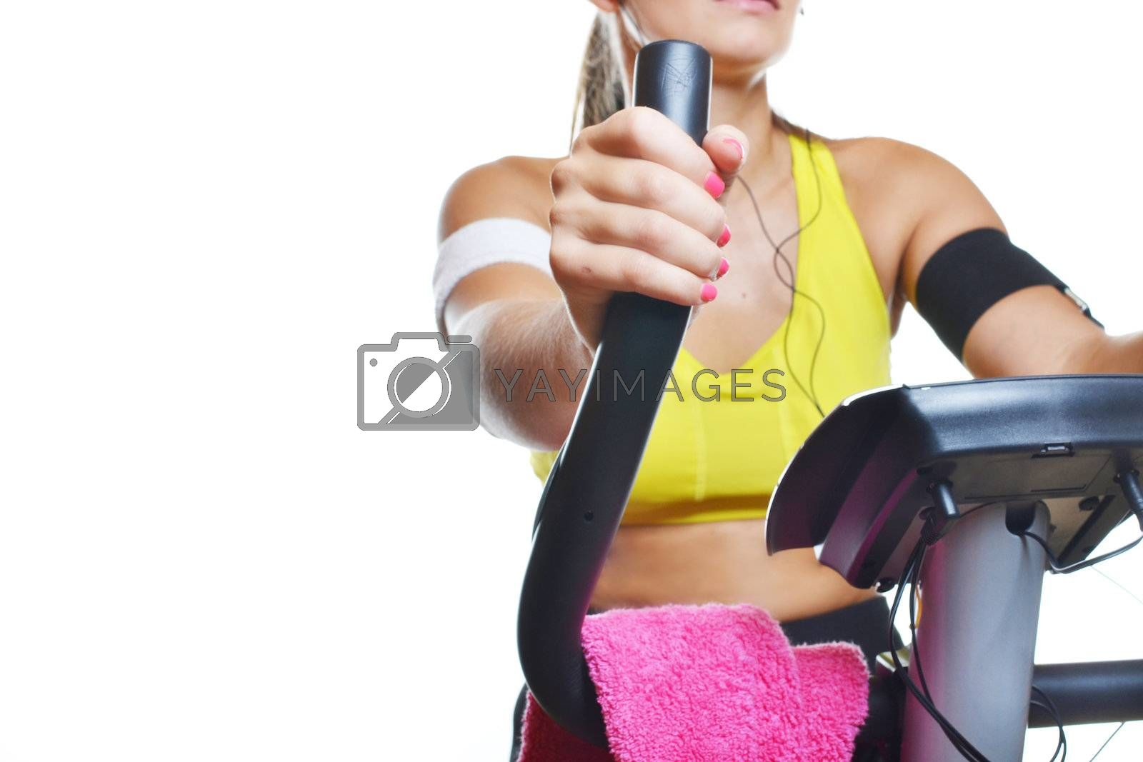 beautiful young woman exercising on bike, isolated on white background