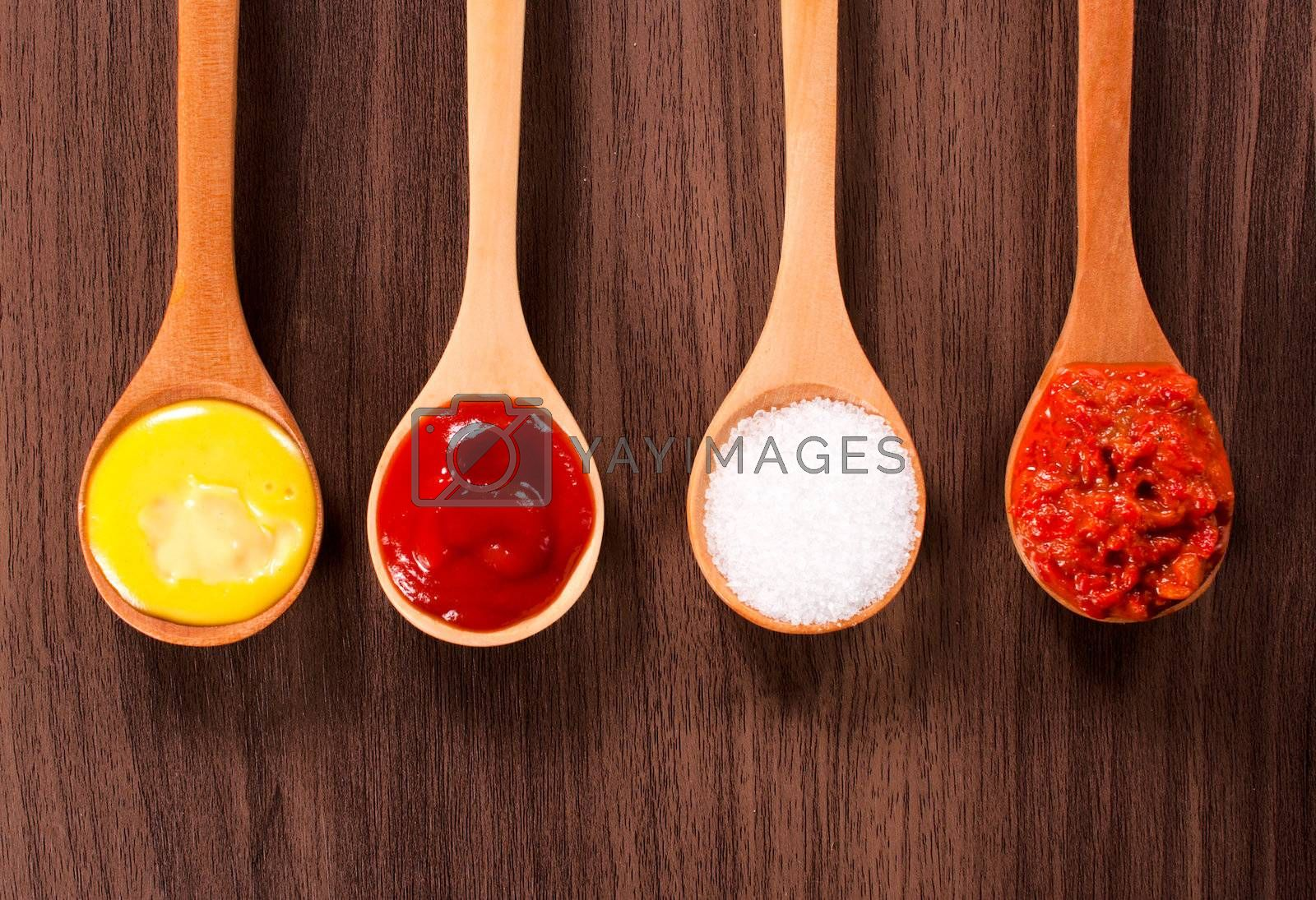 Food ingredients in the wooden ladles from above