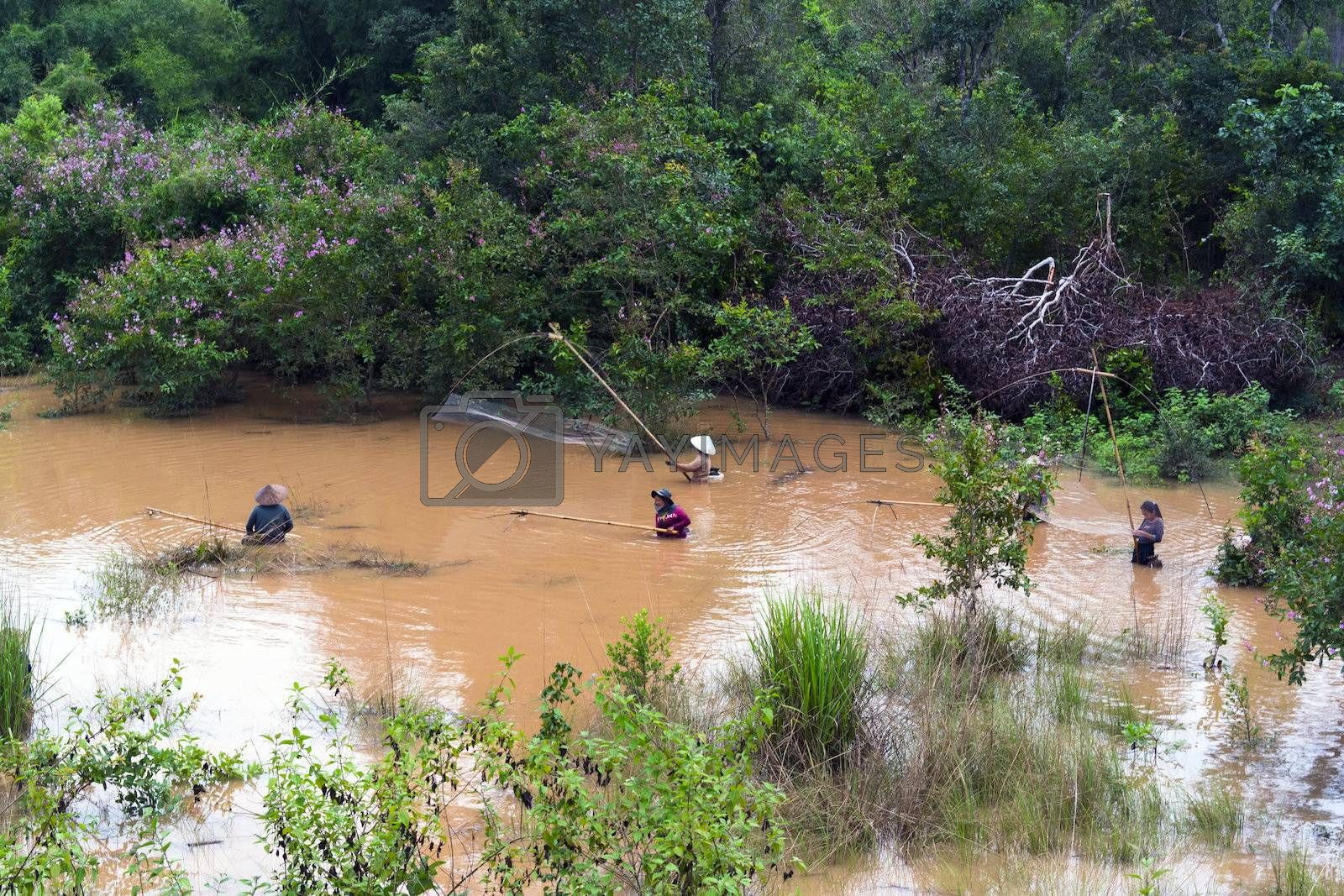 Lao Women Catch Fish in River. Khammouane province. EDITORIAL.