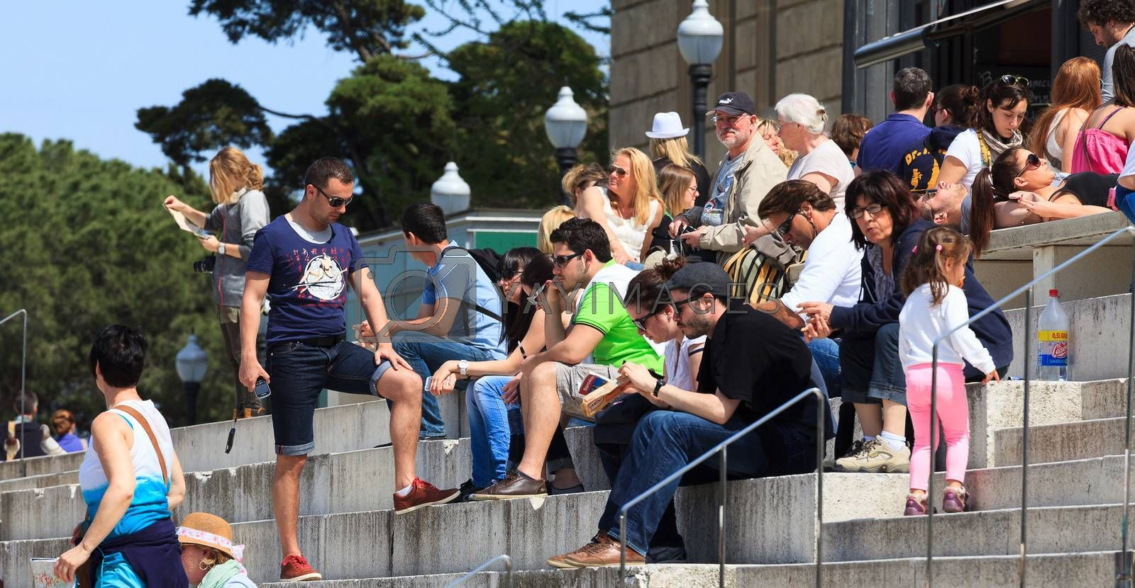 BARCELONA, SPAIN - APRIL 16, 2013: Tourists sit on the stairs of National Art Museum of Catalonia on April 16, 2013 in Barcelona, Spain. The museum is especially notable for its outstanding collection of romanesque church paintings