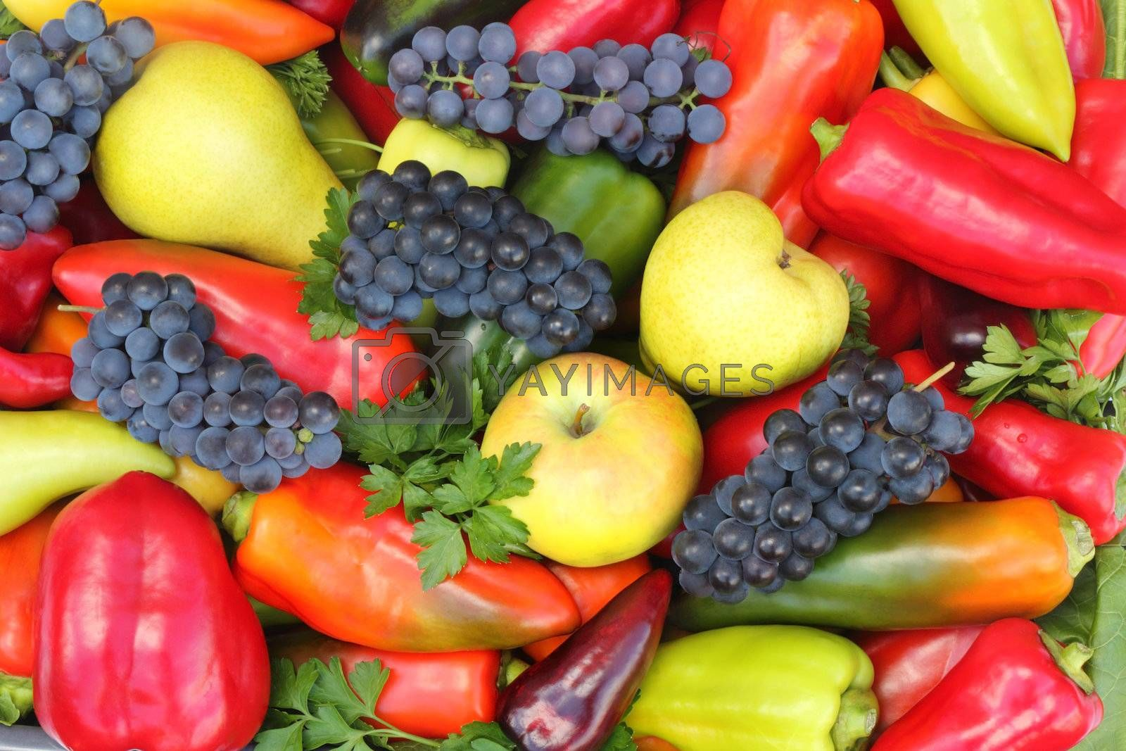 A variety of ripe fruit, apples, pears, grapes, and yellow, red and green peppers.