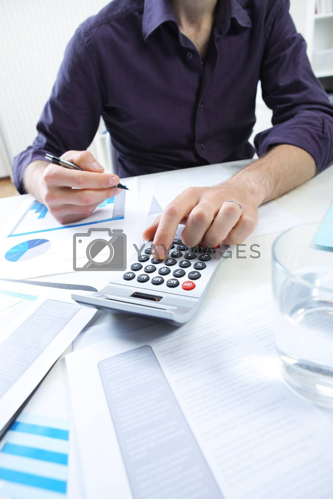 Close-up of businessman checking a financial analyze