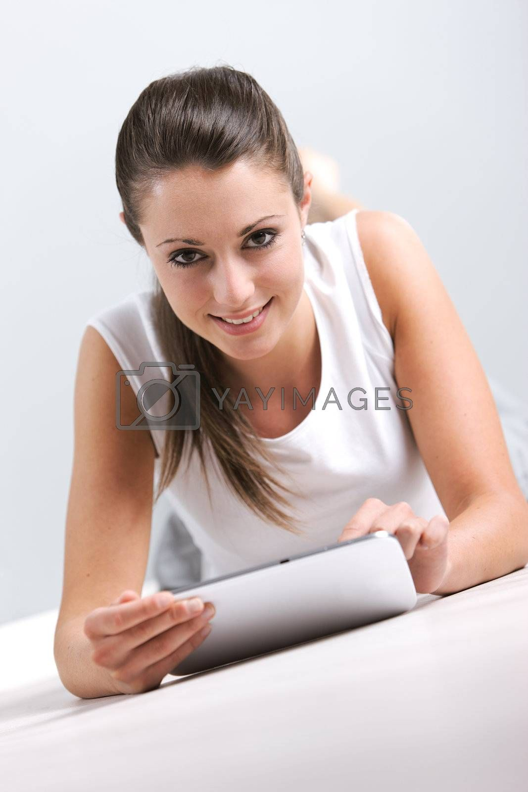 Portrait of smiling young woman whit her digital touchpad