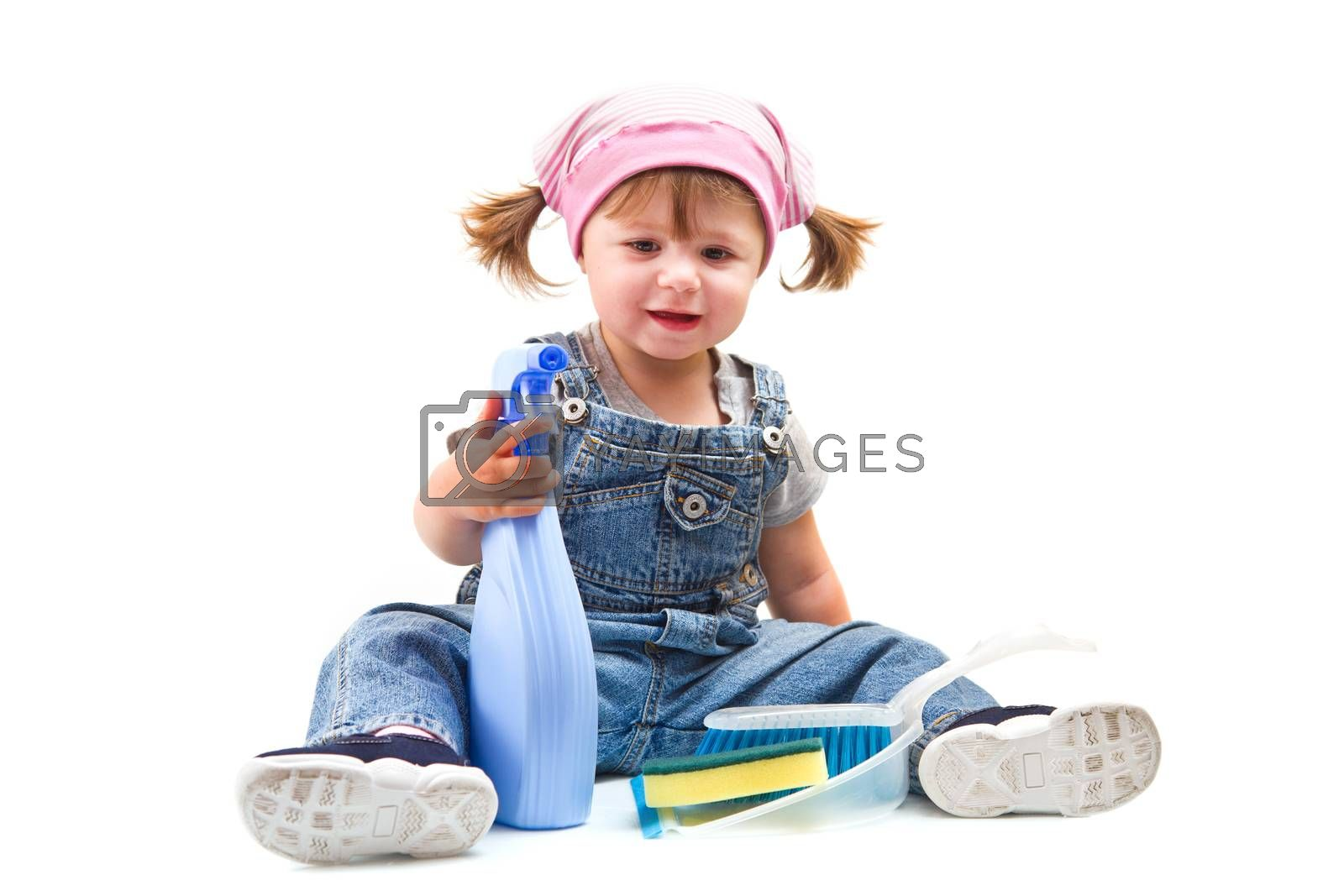 Sweet little girl doing housework