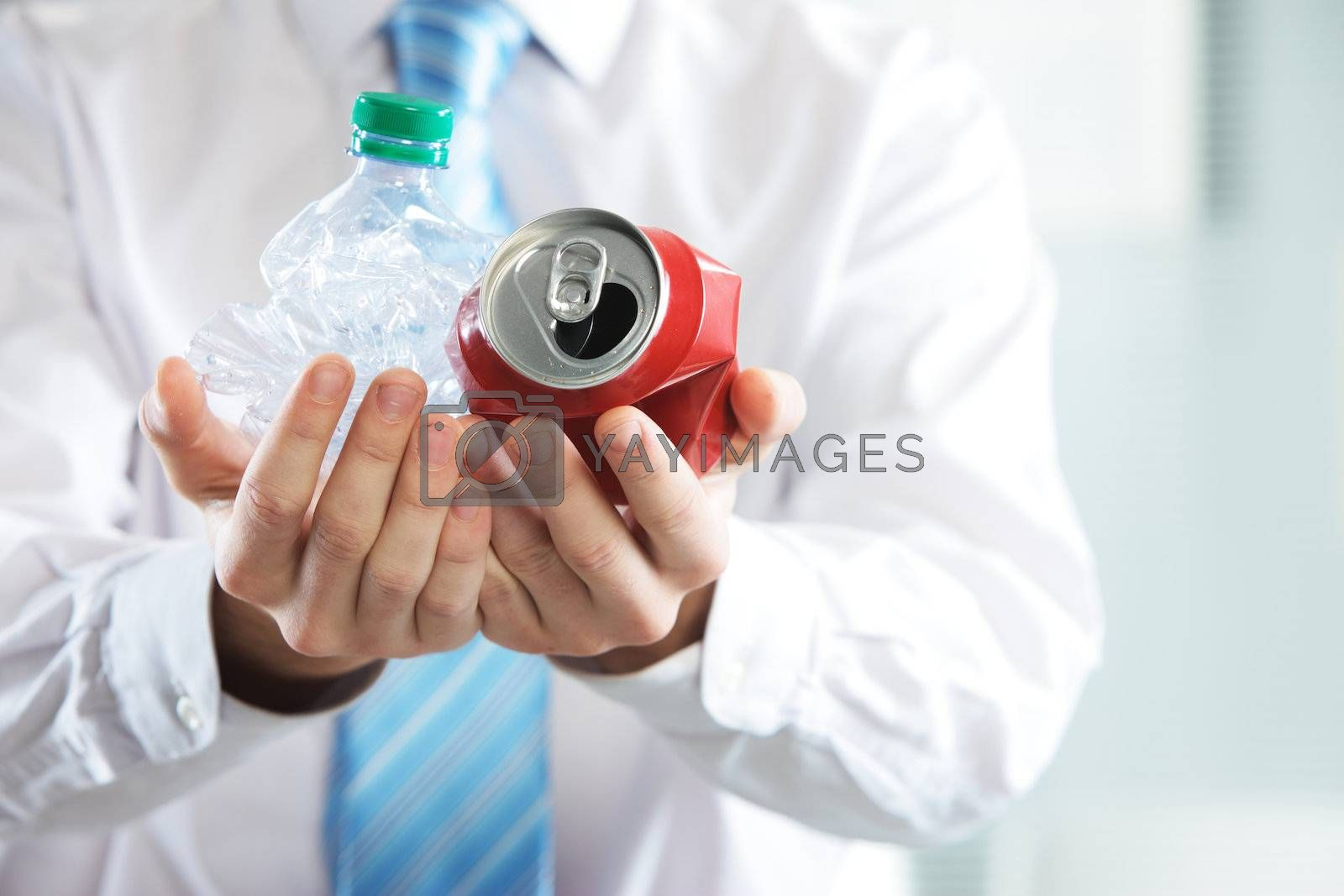 Businessman holding a crashed bottle and drink can, Recycle concept