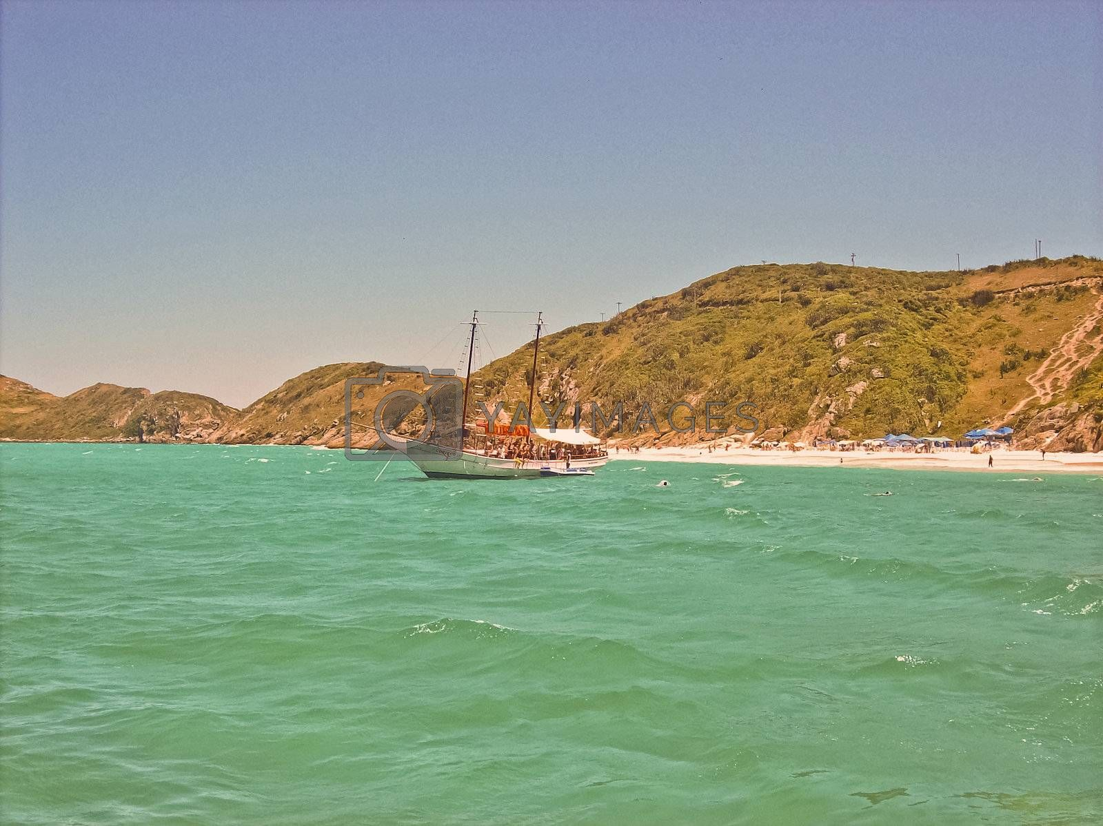 Small passenger boat in a beach of Buzios, Brasil, taken from another boat.