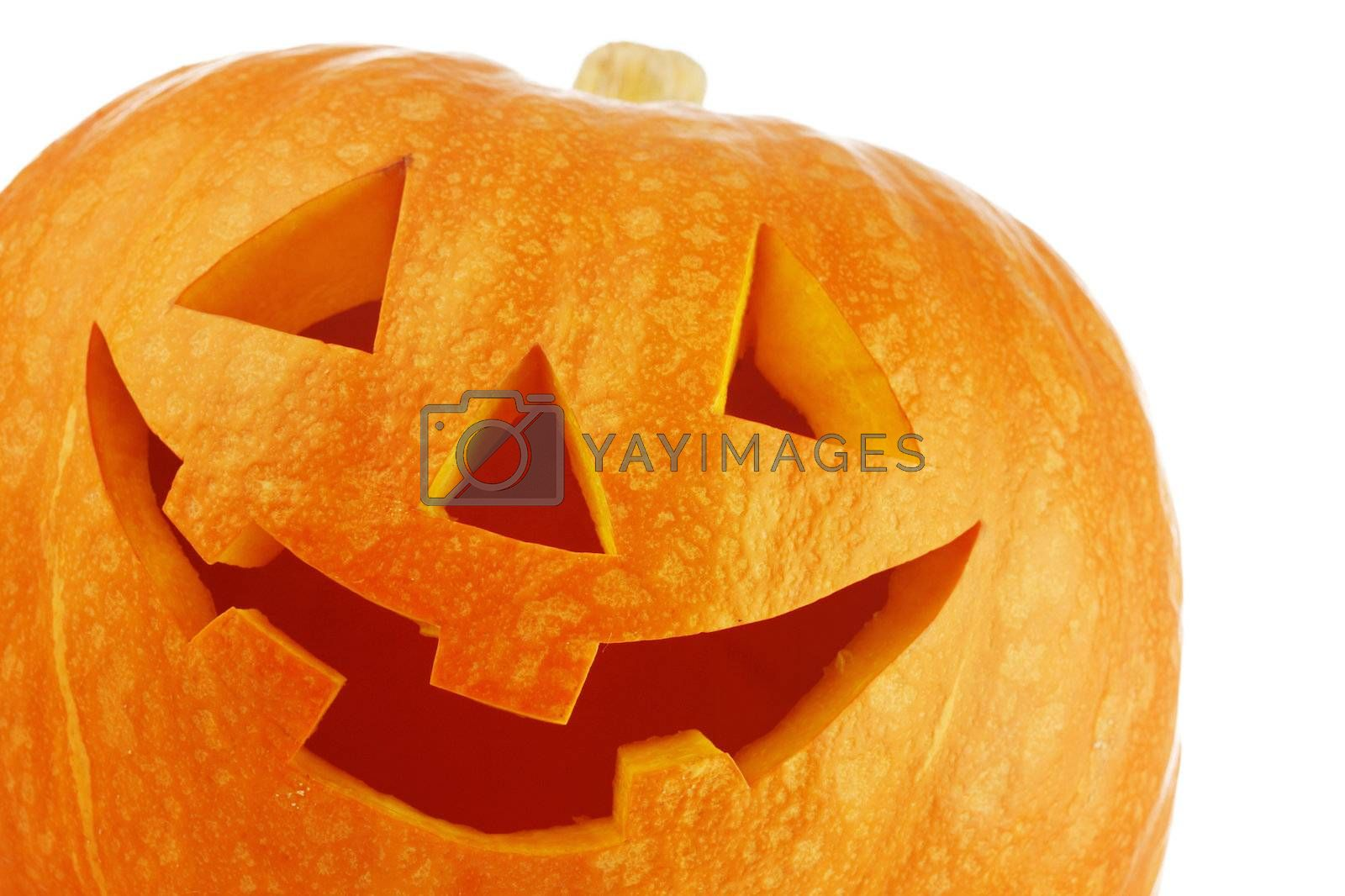 Funny carved Halloween pumpkin on white background