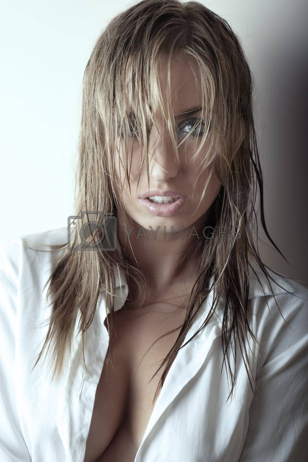 Pretty woman with big breast and wet hair in open shirt