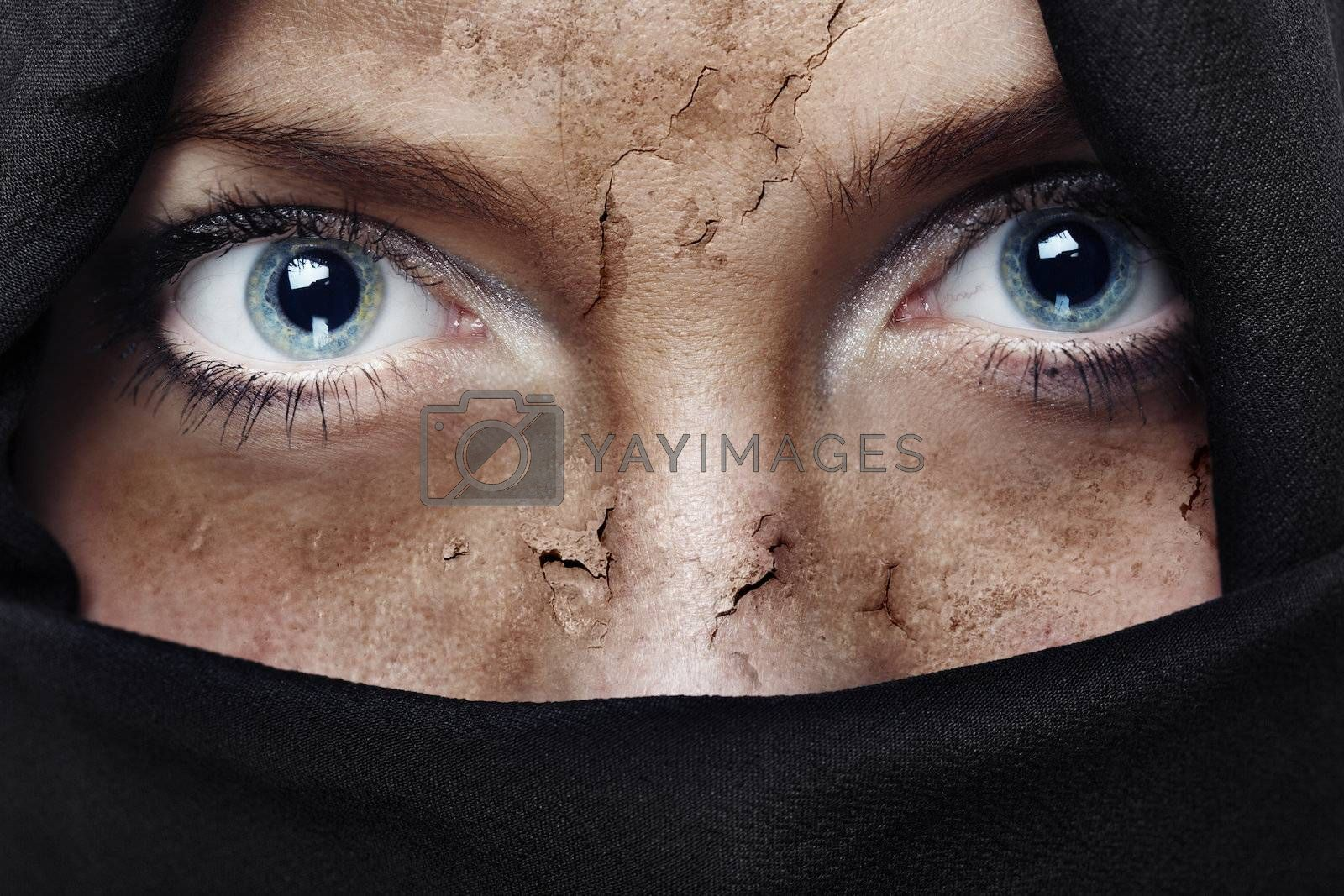 Face with damaged skin covered by headscarf