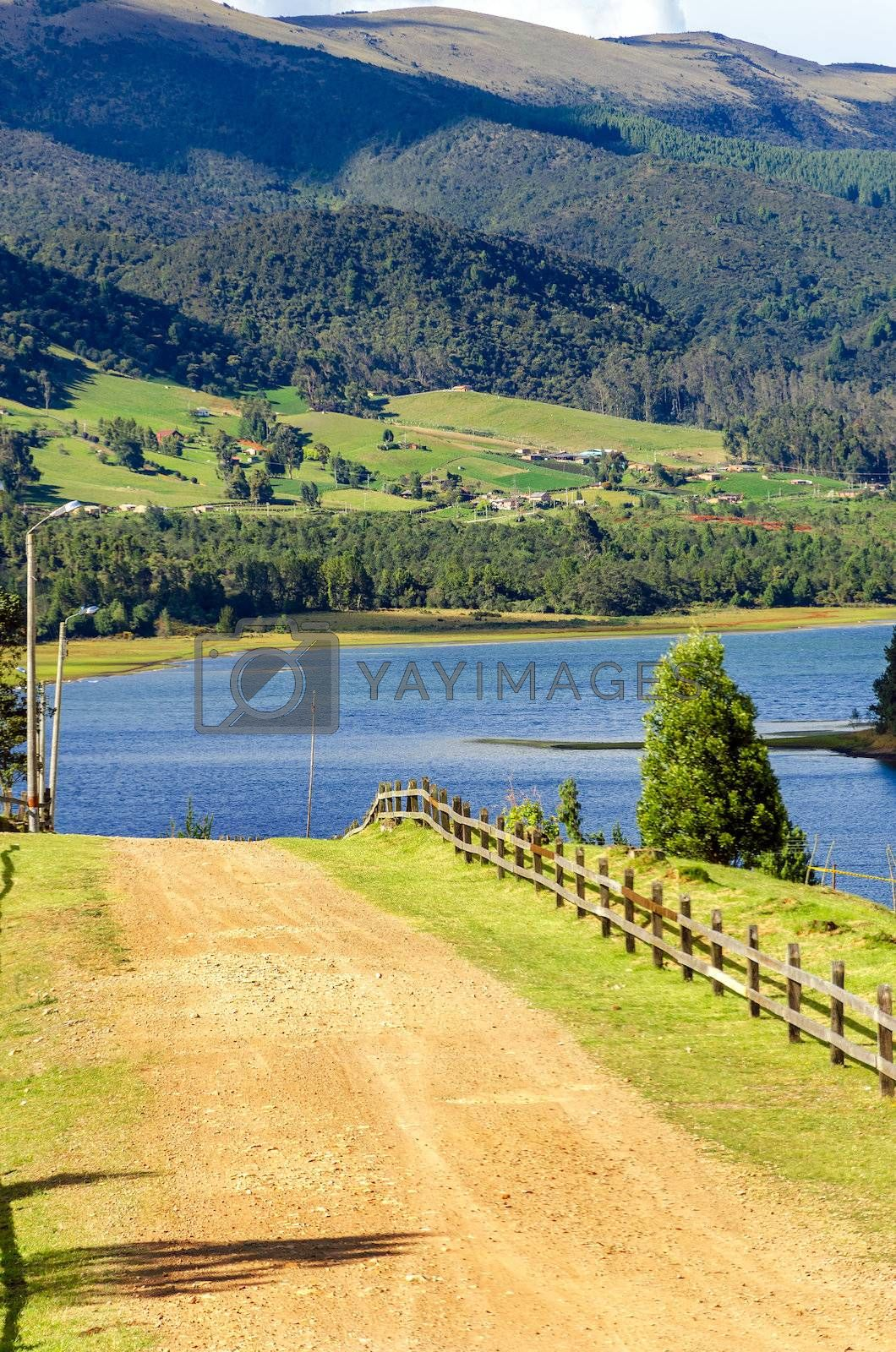 Country road in Neusa, Colombia leading to the shore of a beautiful blue lake