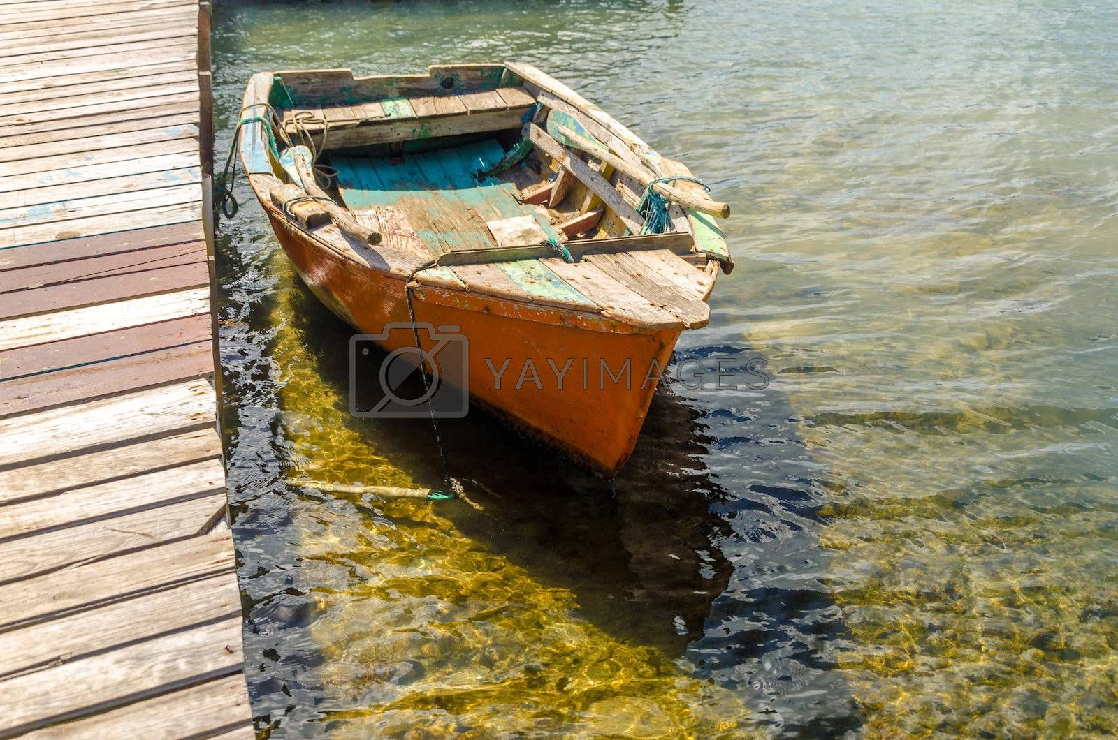 Old orange boat by a pier in San Andres y Providencia, Colombia