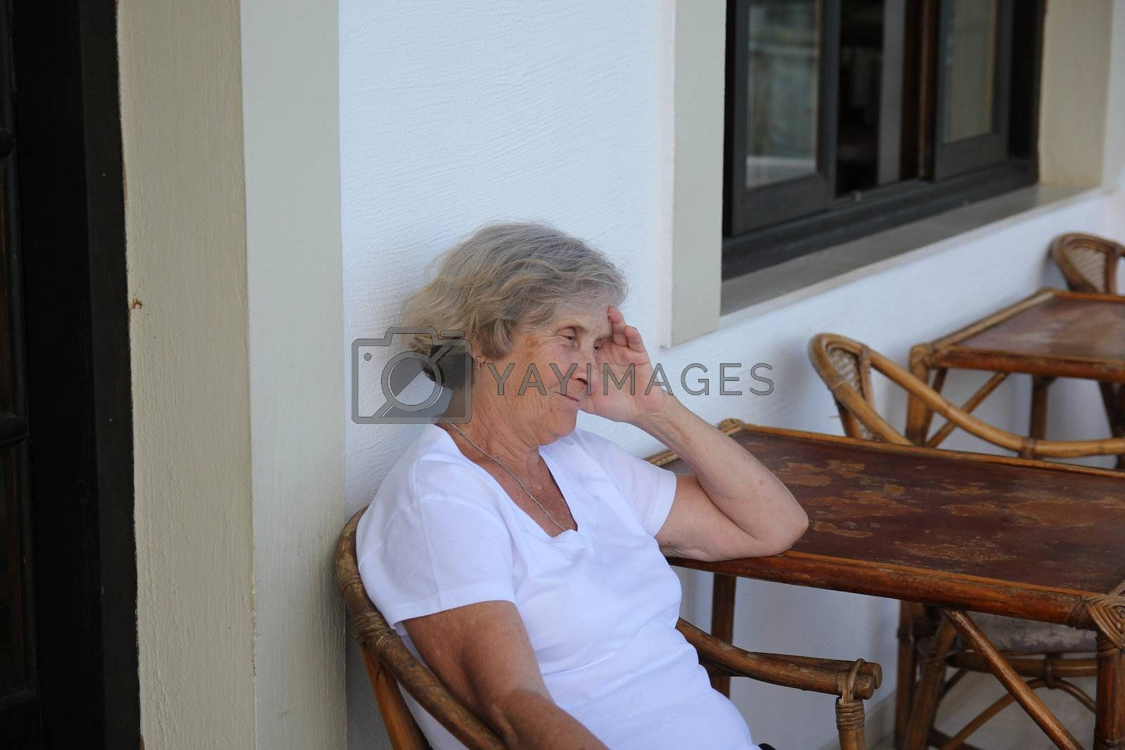 Smiling elderly woman sitting at the table