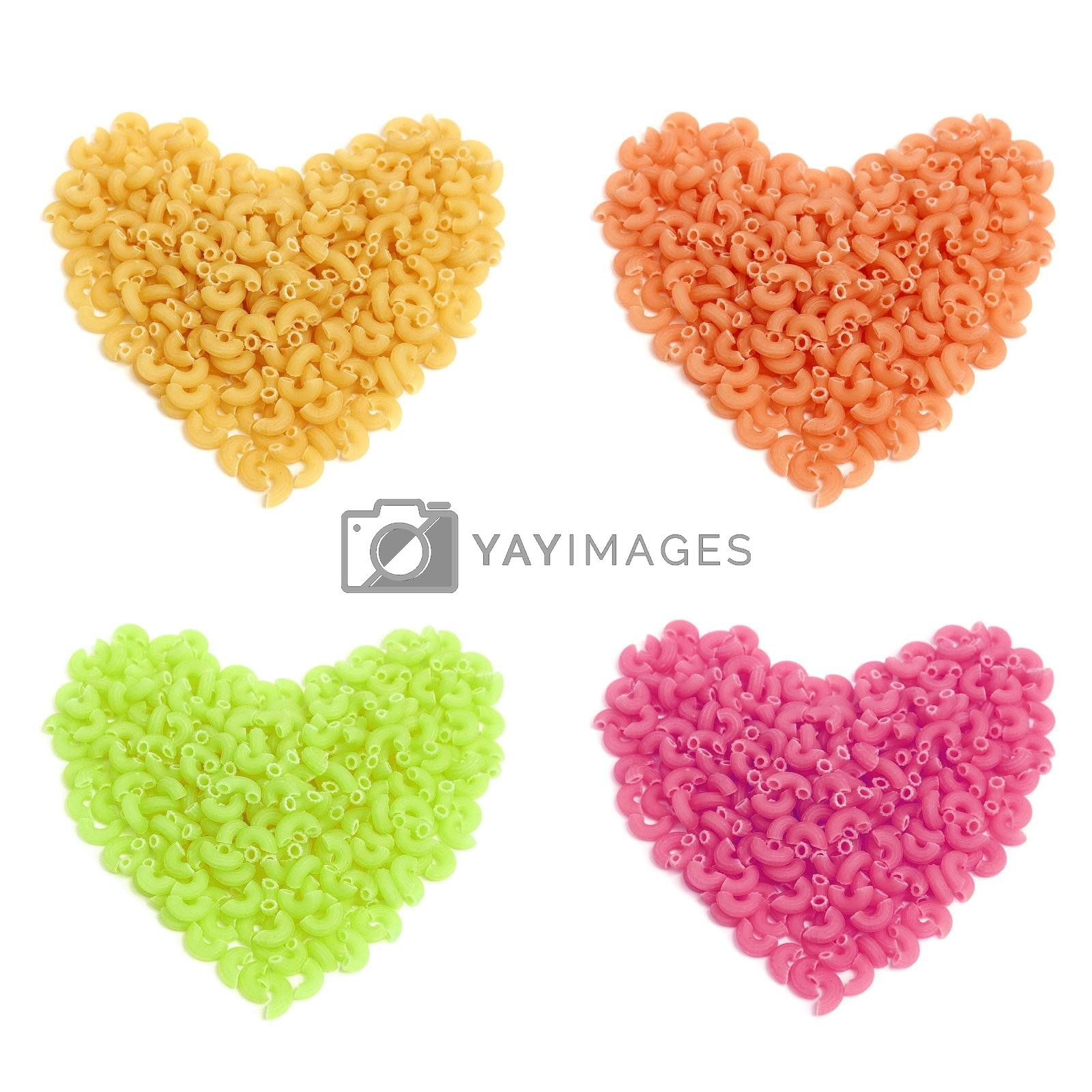 Colorful macaroni in heart shape isolated on white background