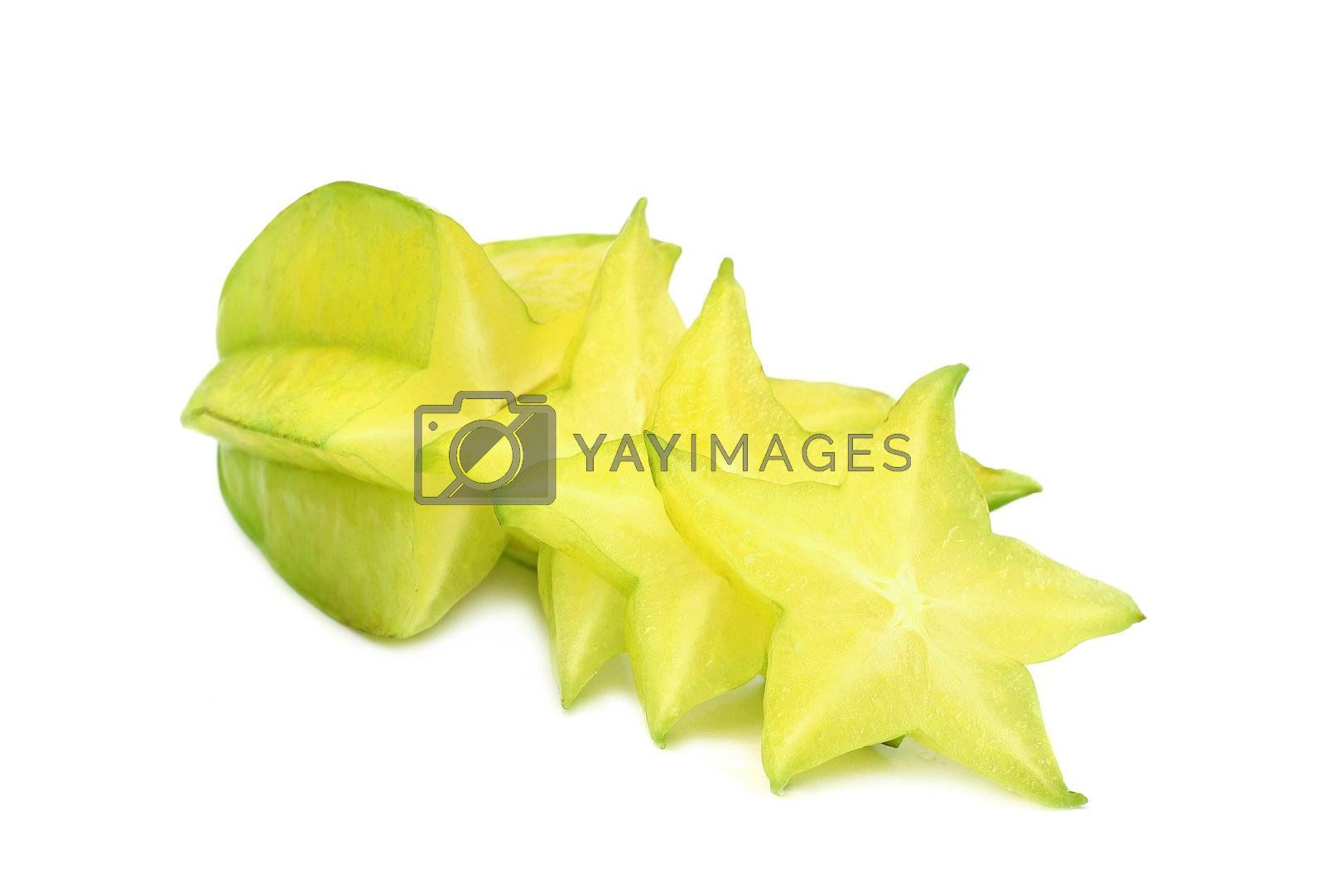 Ripe carambola with slice isolated on white background