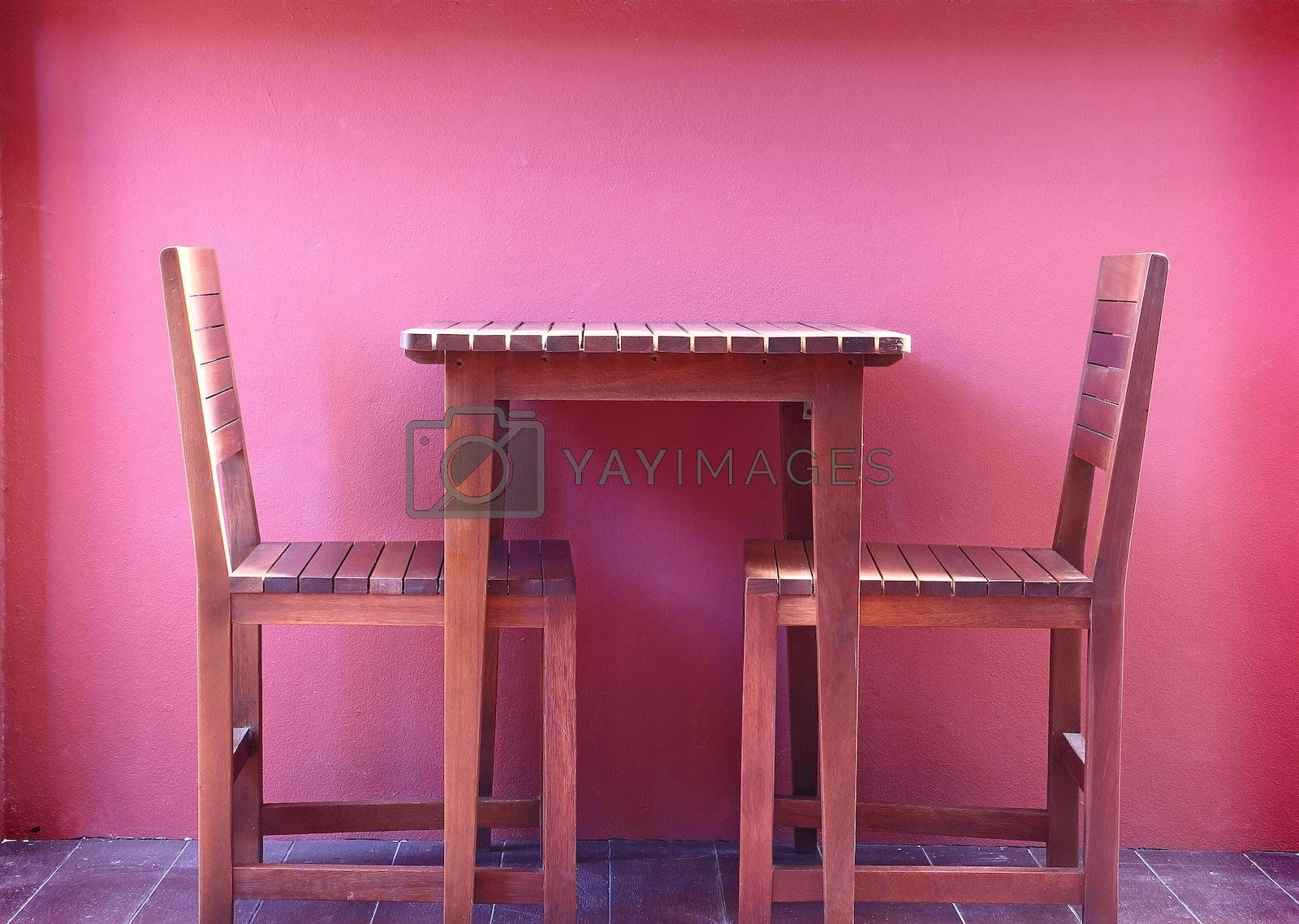 Wooden chairs with red wall