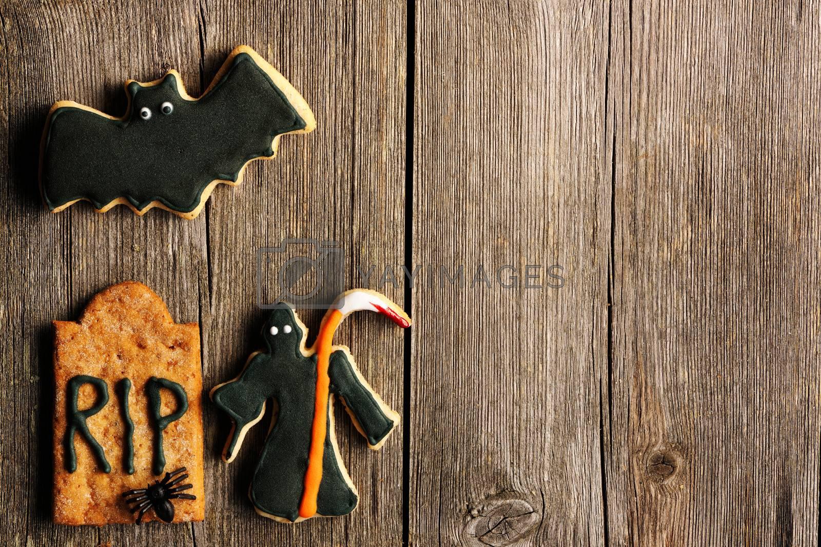 Halloween homemade gingerbread cookies over wooden table