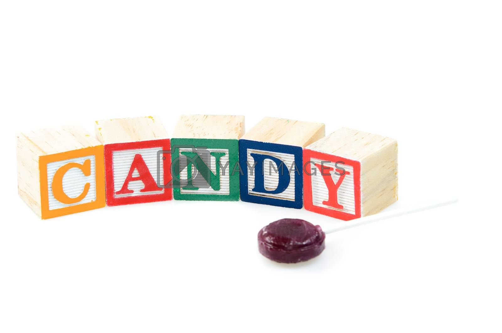 Baby blocks spelling candy. Isolated on a white background.