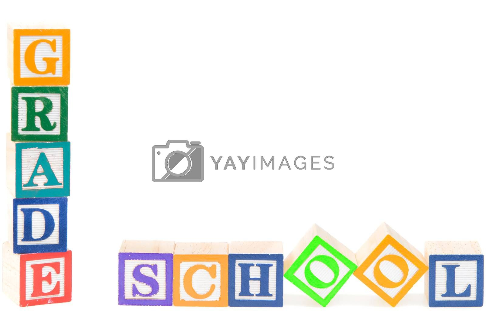 Baby blocks spelling grade school. Isolated on white background.