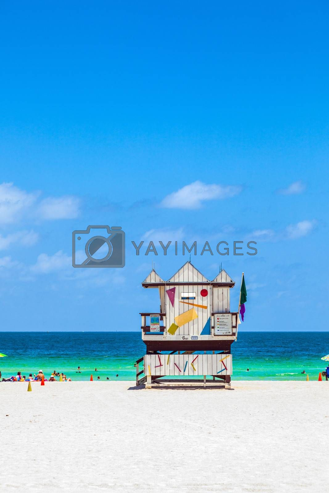 MIAMI, USA - JULY 27: people enjoy the beach on July 27, 2010 in Miami, USA. South beach is famous for its wooden lifeguard towers which are designed in Art deco style.