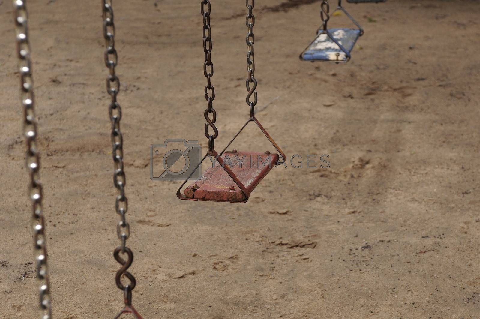 An old swing at abandoned playground