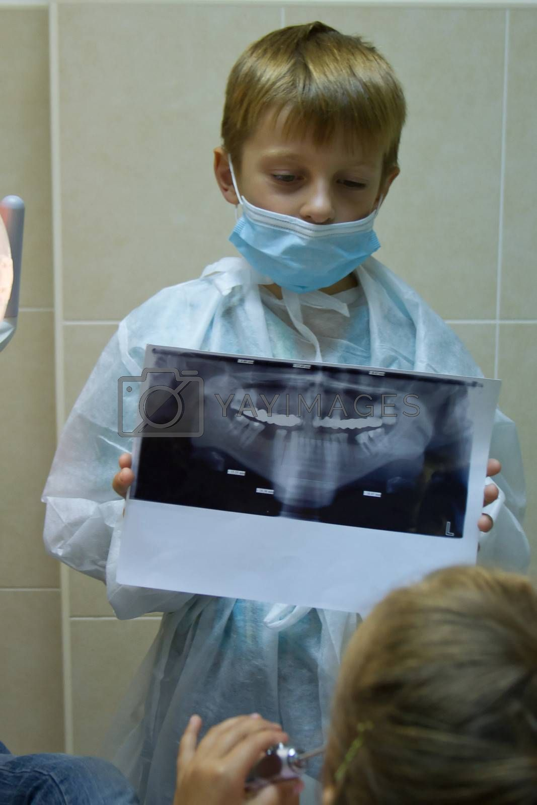 child plays in a dentist. Choosing a profession