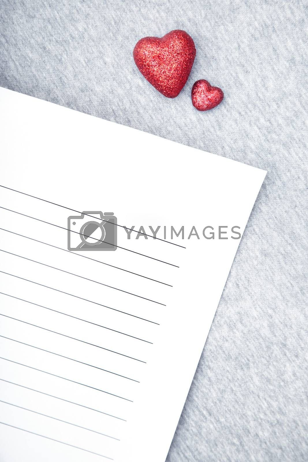 Two small hearts and love letter for Valentine Day