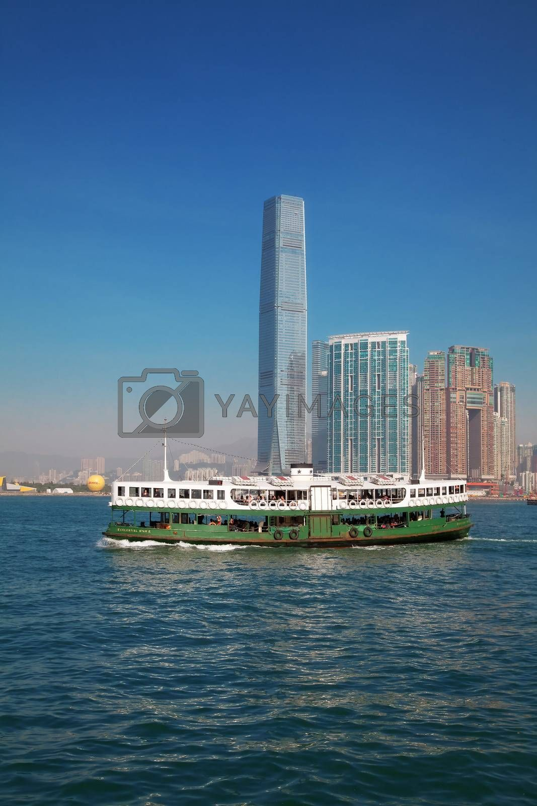 """HONG KONG - DECEMBER 3: Ferry """"Celestial star"""" cruising Victoria harbor on December 3, 2010 in Hong Kong. Hong Kong ferry is in operation for more than 120 years and it is one main tourist attractions of the city."""