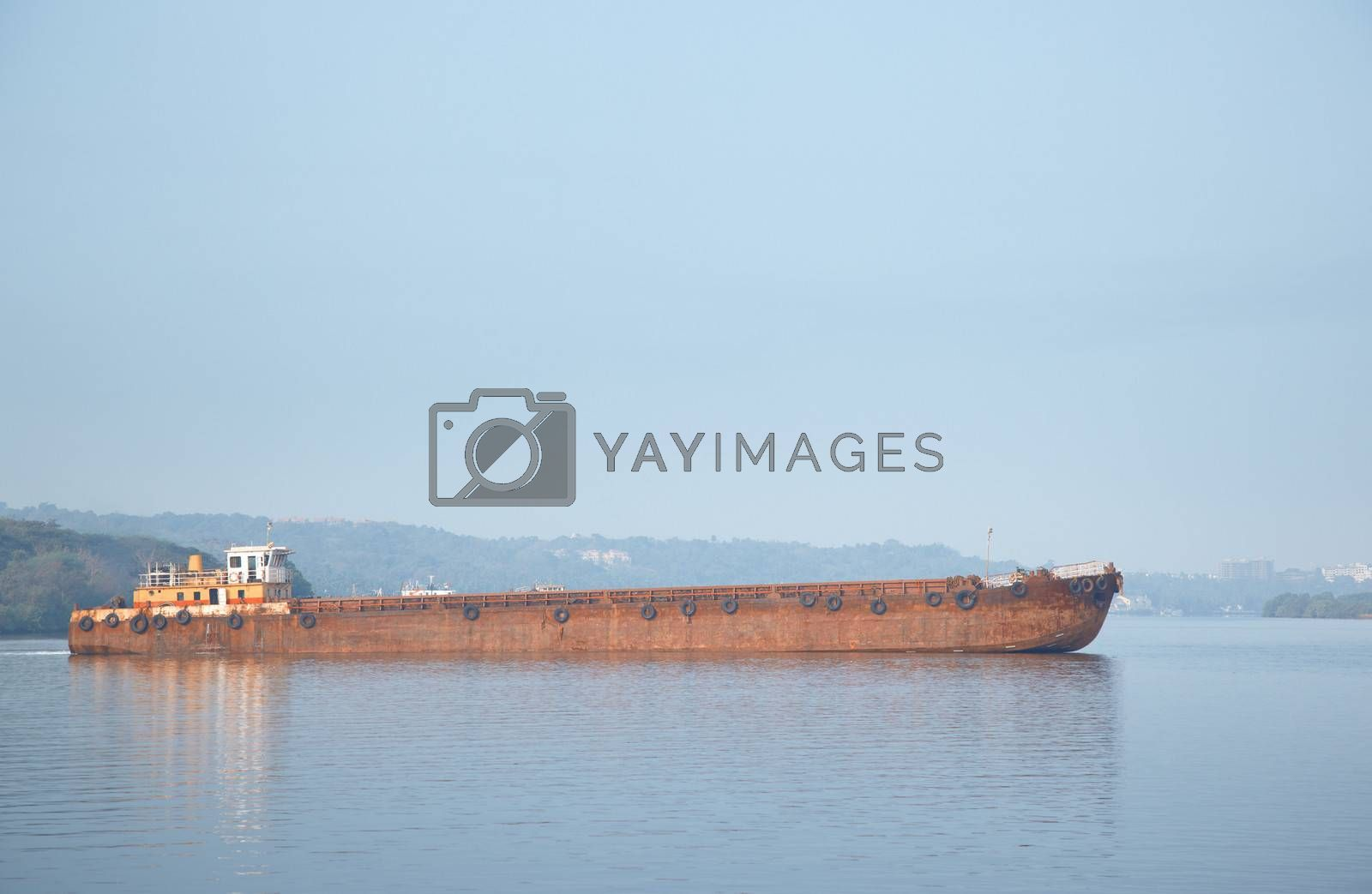 Old cargo vessel in the sea. Horizontal photo