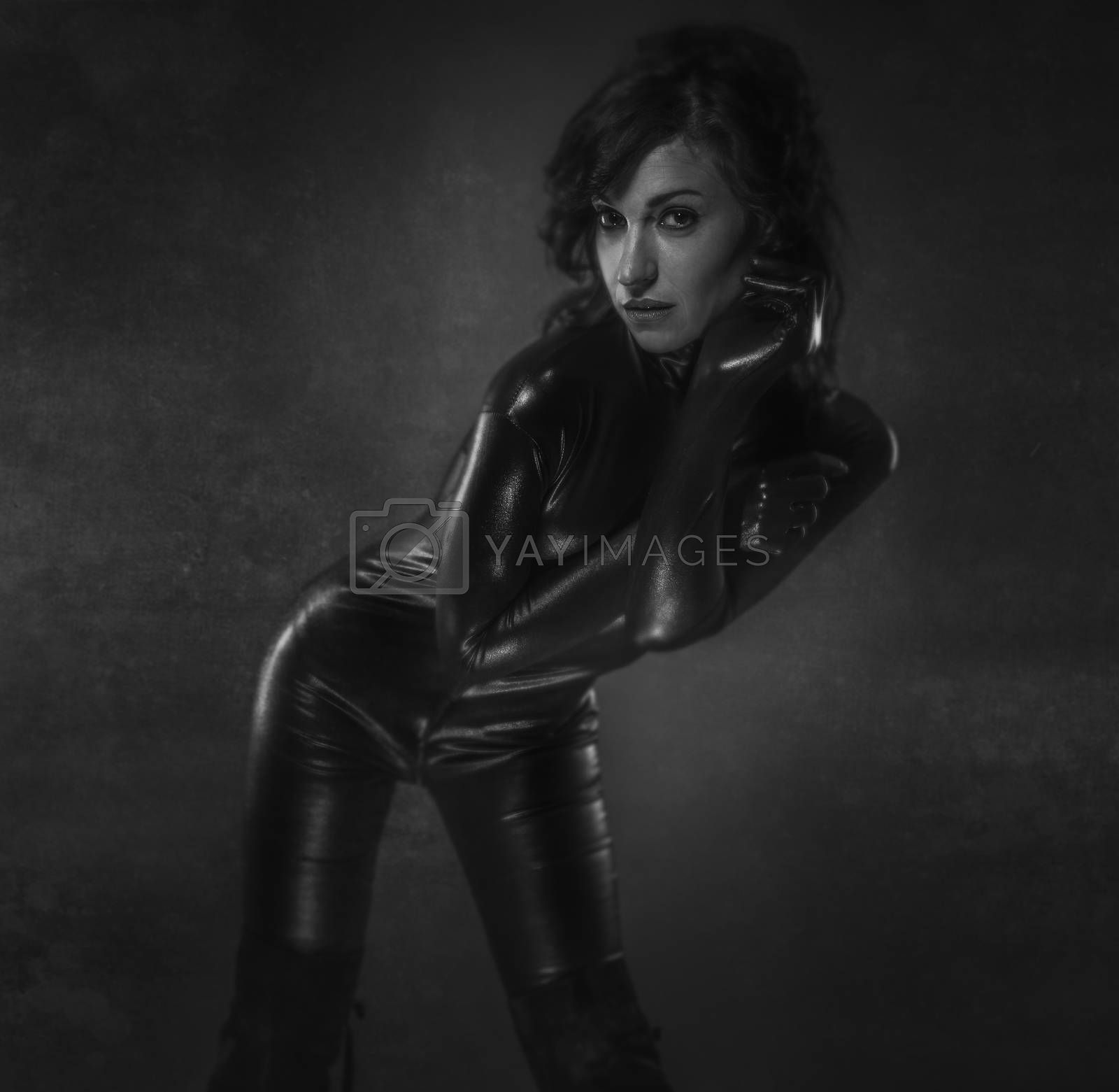 Young sexy latex woman on artistic grey background