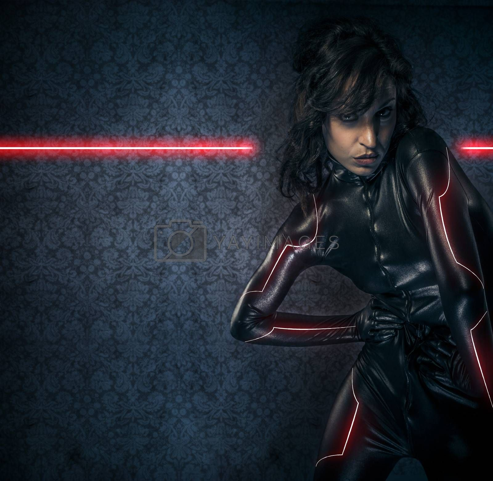 Sexy brunette in black latex costume , science fiction scene, fantasy armor with red lights